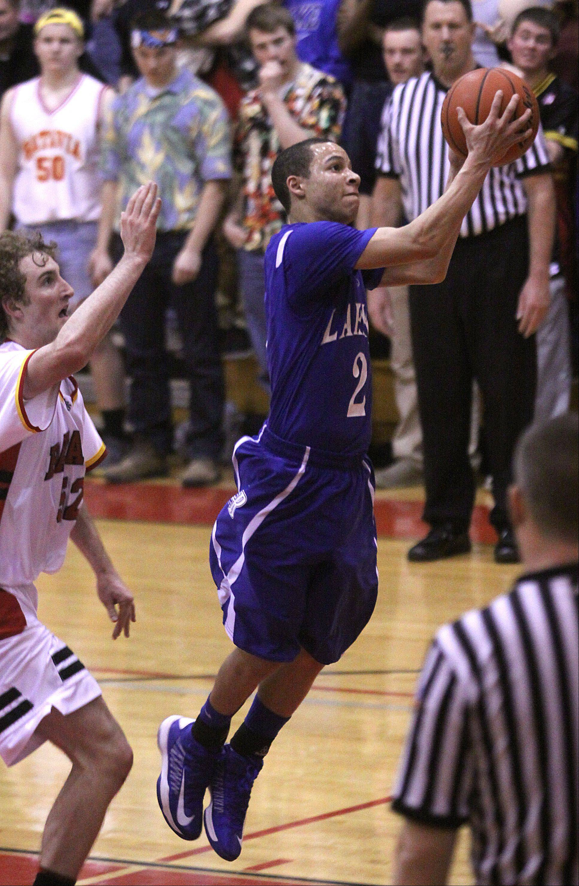 Batavia's Luke Horton, left watches as Larkin's Derrick Streety soars toward the hoop during a varsity basketball game at Batavia on Thursday night.