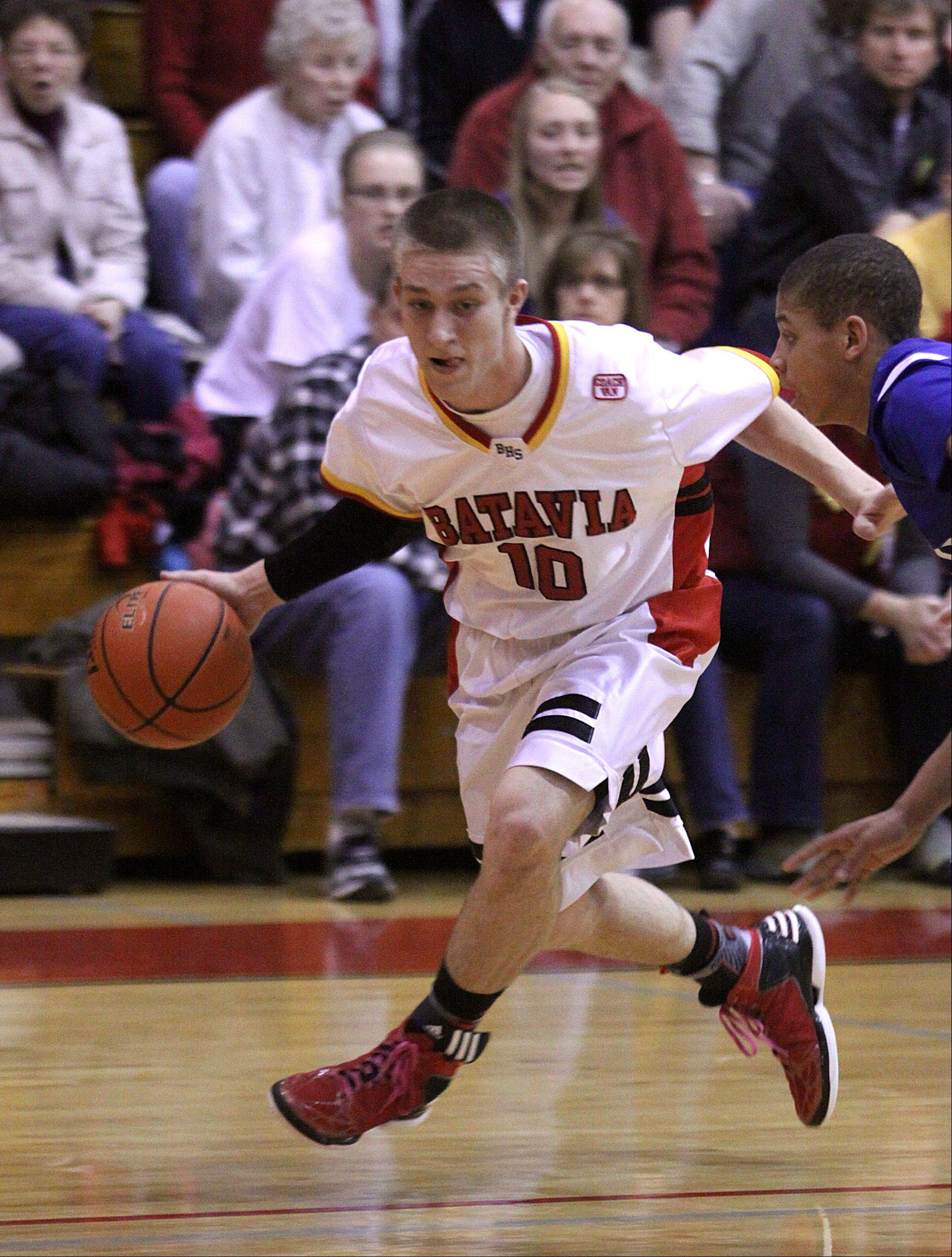 Batavia's Mike Rueffer moves the ball against Larkin during a varsity basketball game at Batavia on Thursday night.