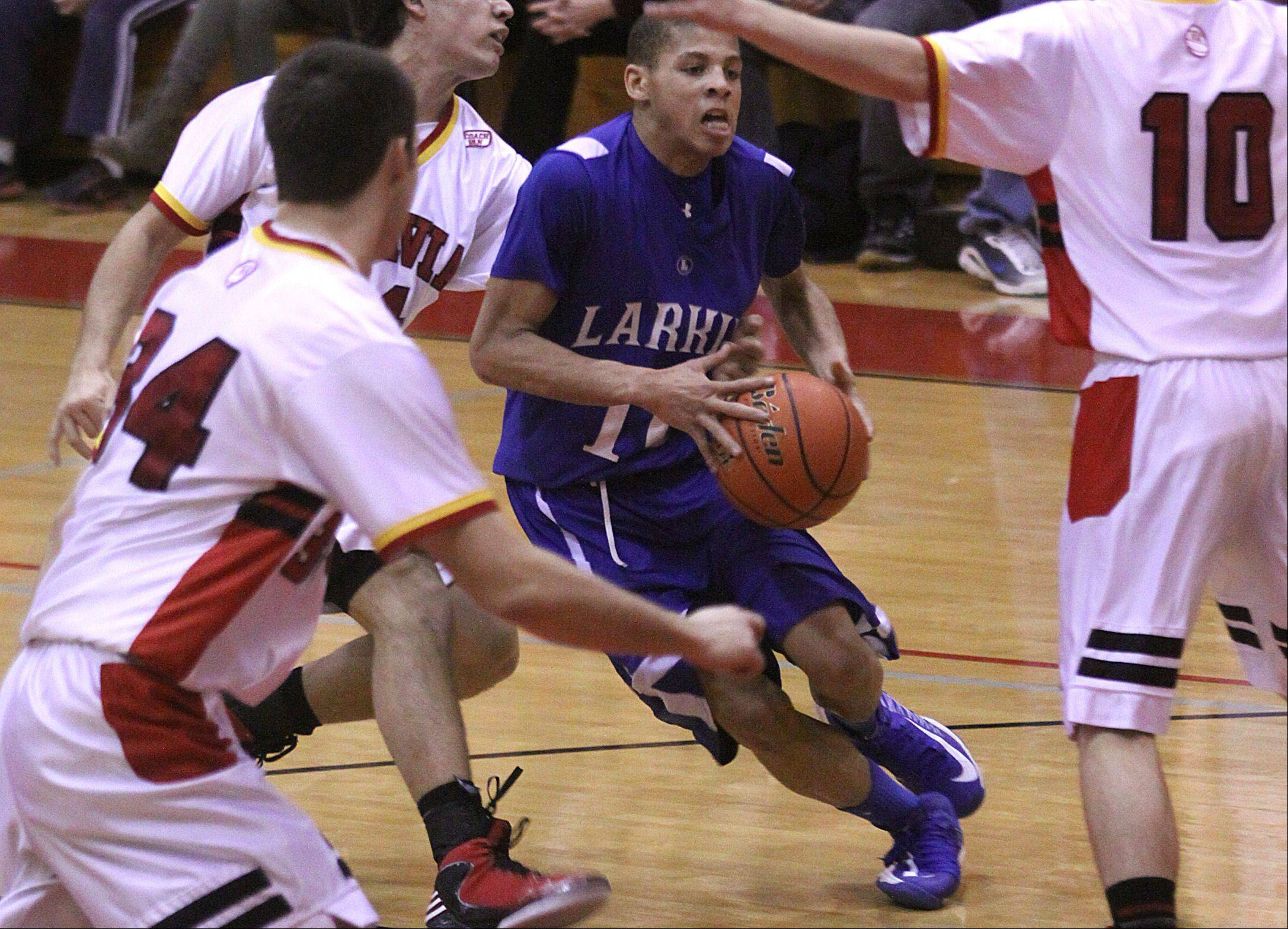Larkin's Kendale McCullum moves the ball during a varsity basketball game at Batavia on Thursday night.