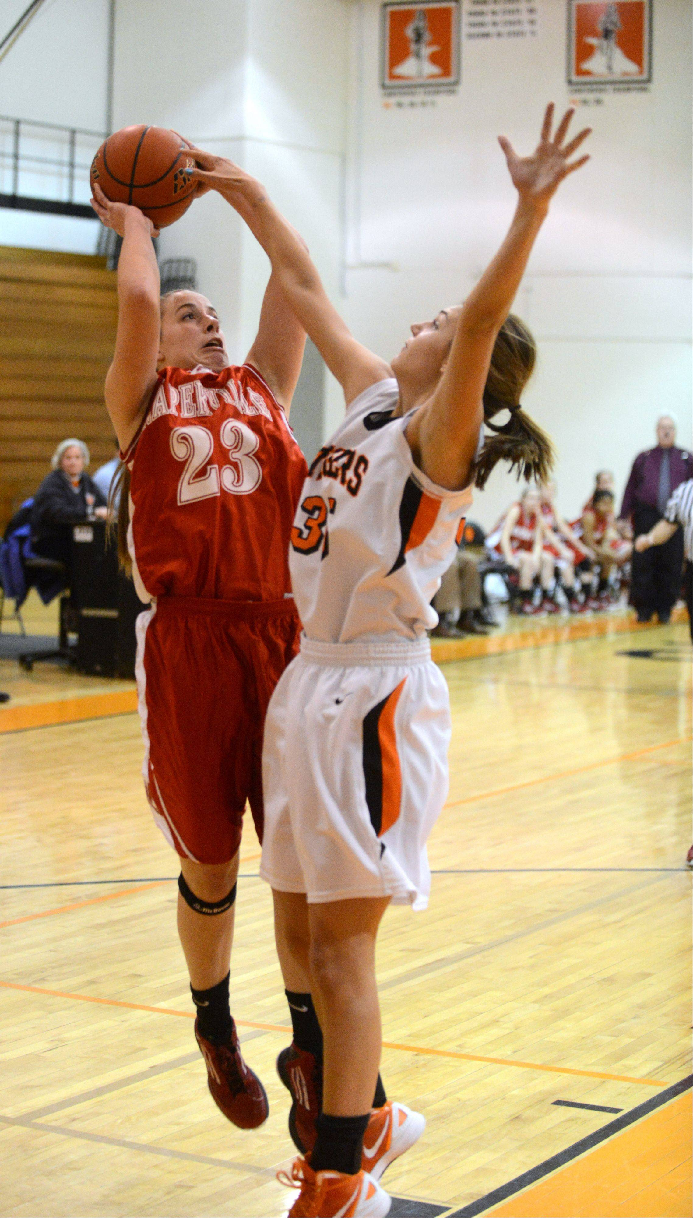 Laura Dierking of Naperville Central puts up a shot over Allie Zappia of Wheaton Warrenville South during the Naperville Central at Wheaton Warrenville South girls basketball game Thursday.