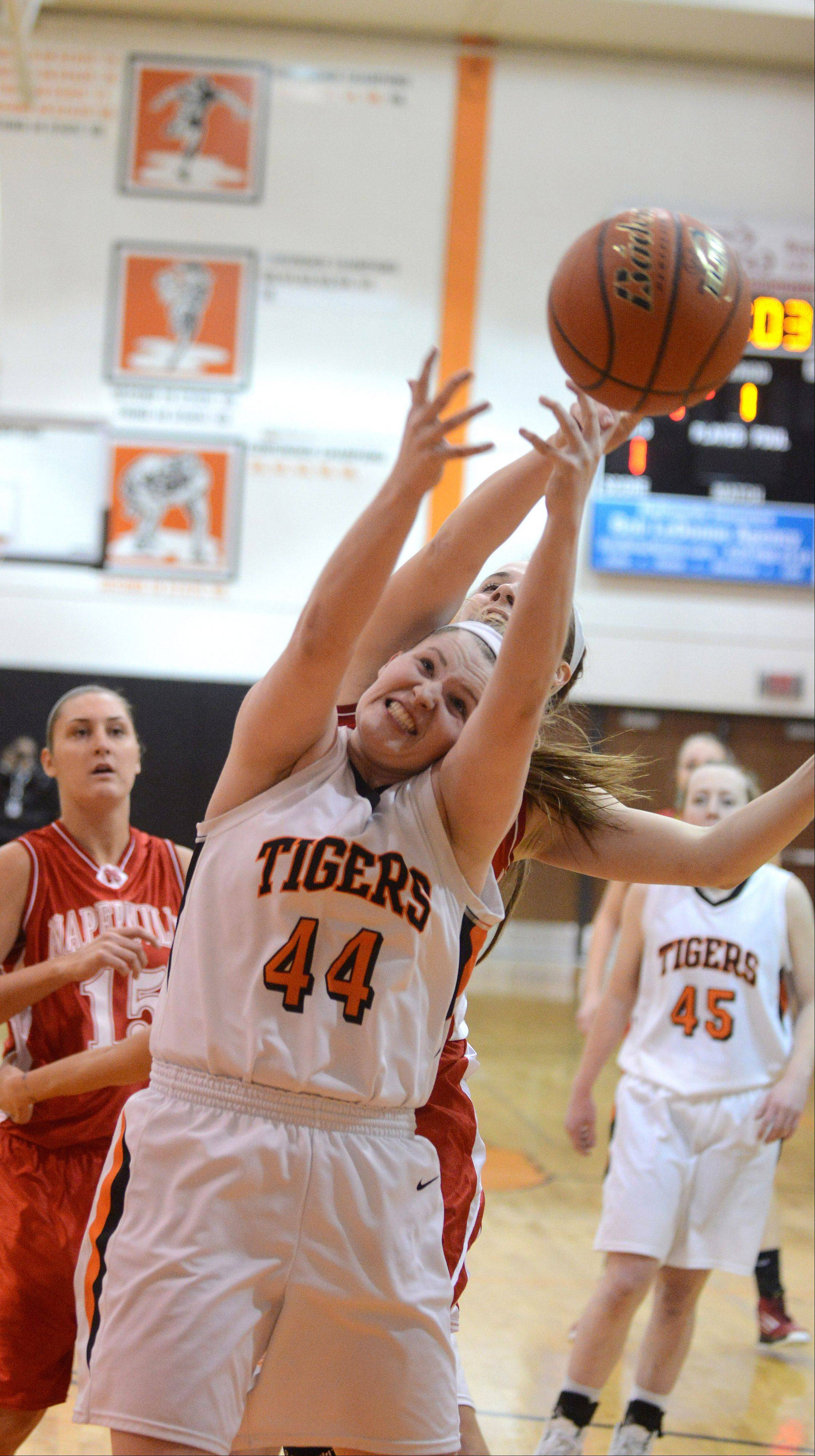Olivia Linebarger of Wheaton Warrenville south goes up for a rebound during the Naperville Central at Wheaton Warrenville South girls basketball game Thursday.