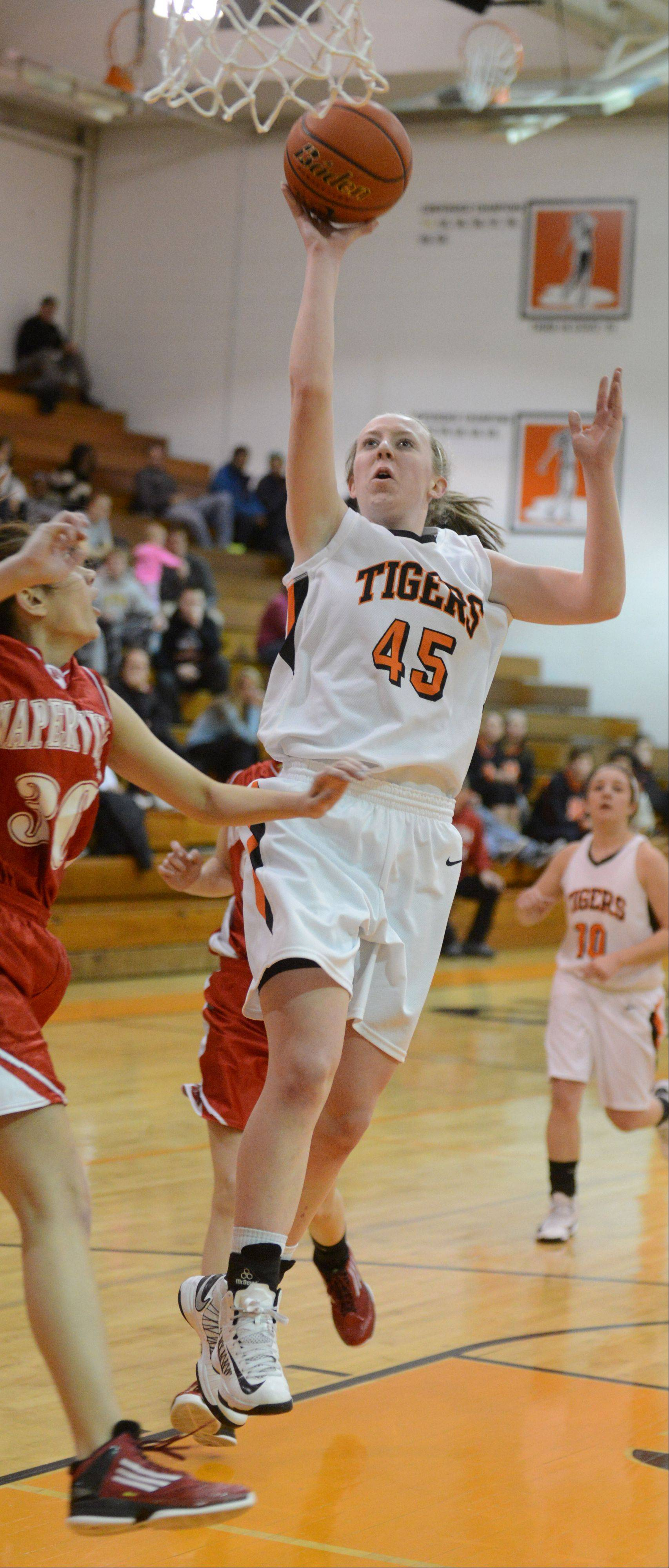Meghan Waldron of Wheaton Warrenville south takes one to the net during the Naperville central at Wheaton Warrenville South girls basketball game Thursday.
