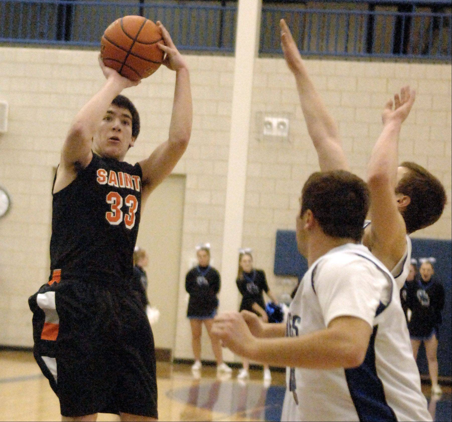 St. Charles East's Jake Asquini scores from the outside during Friday's game in Geneva.