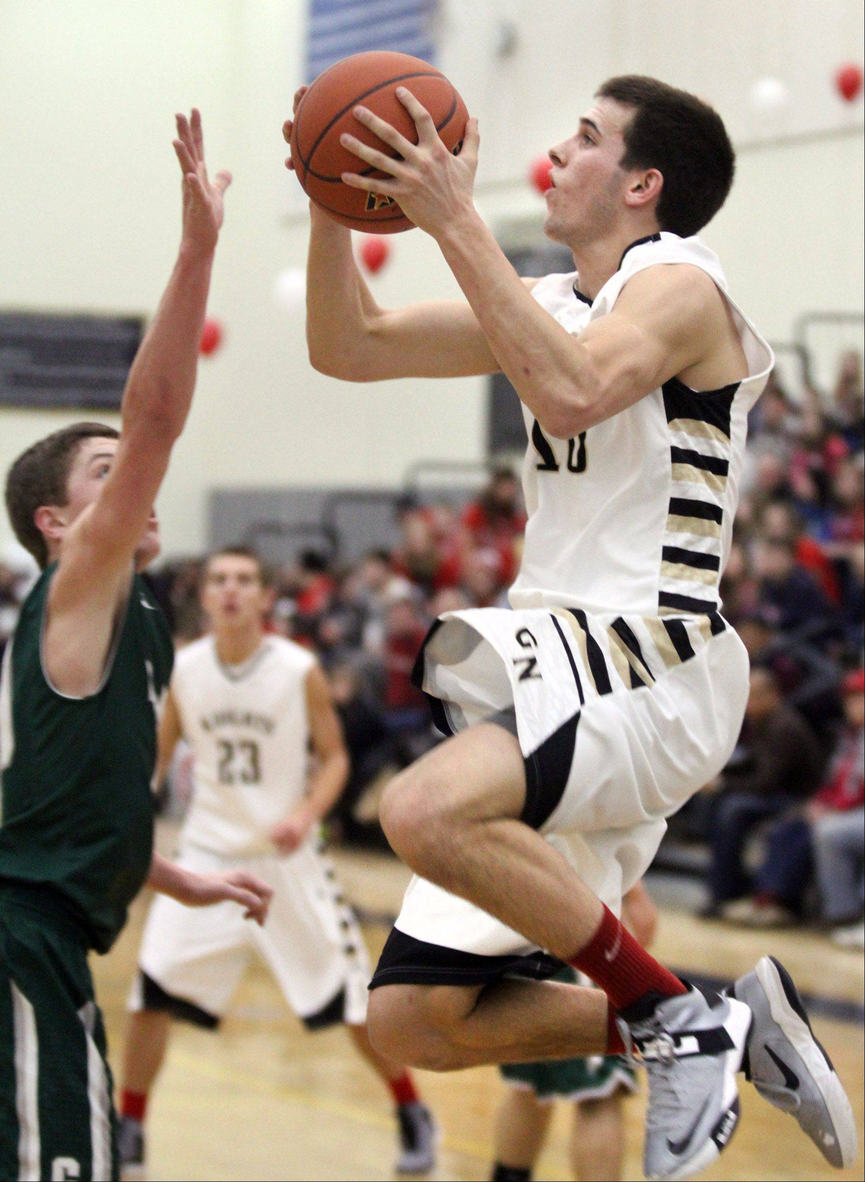 George LeClaire/gleclaire@dailyherald.com Grayslake North forward A.J. Fish puts the ball up against Grayslake Central defender Joey Mudd at Grayslake North on Friday.