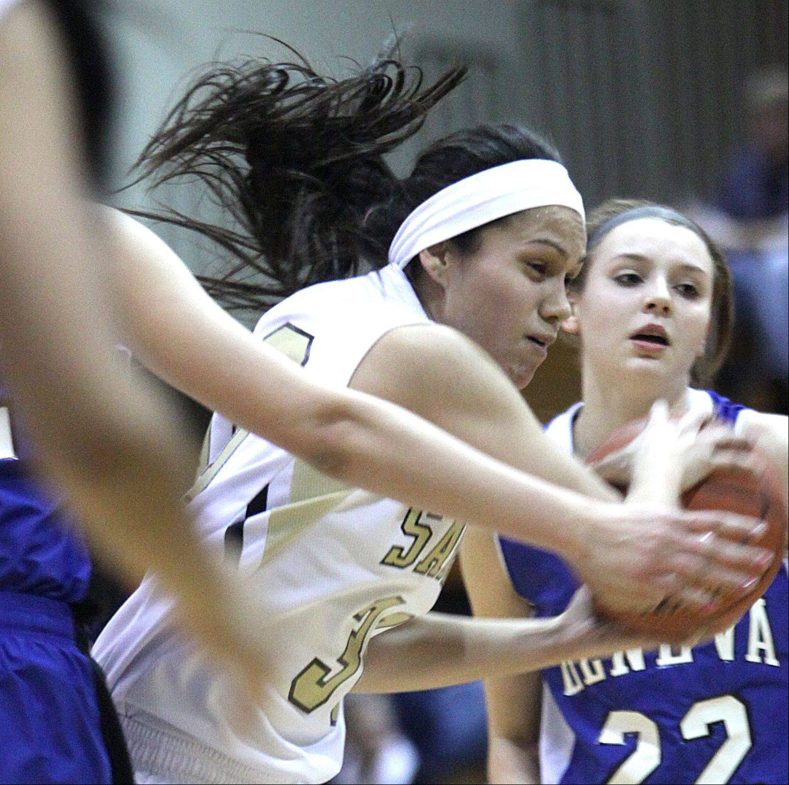 Streamwood's Jessica Cerda moves the ball against Geneva during a varsity basketball game at Streamwood on Friday night. Geneva won the game 54-43.