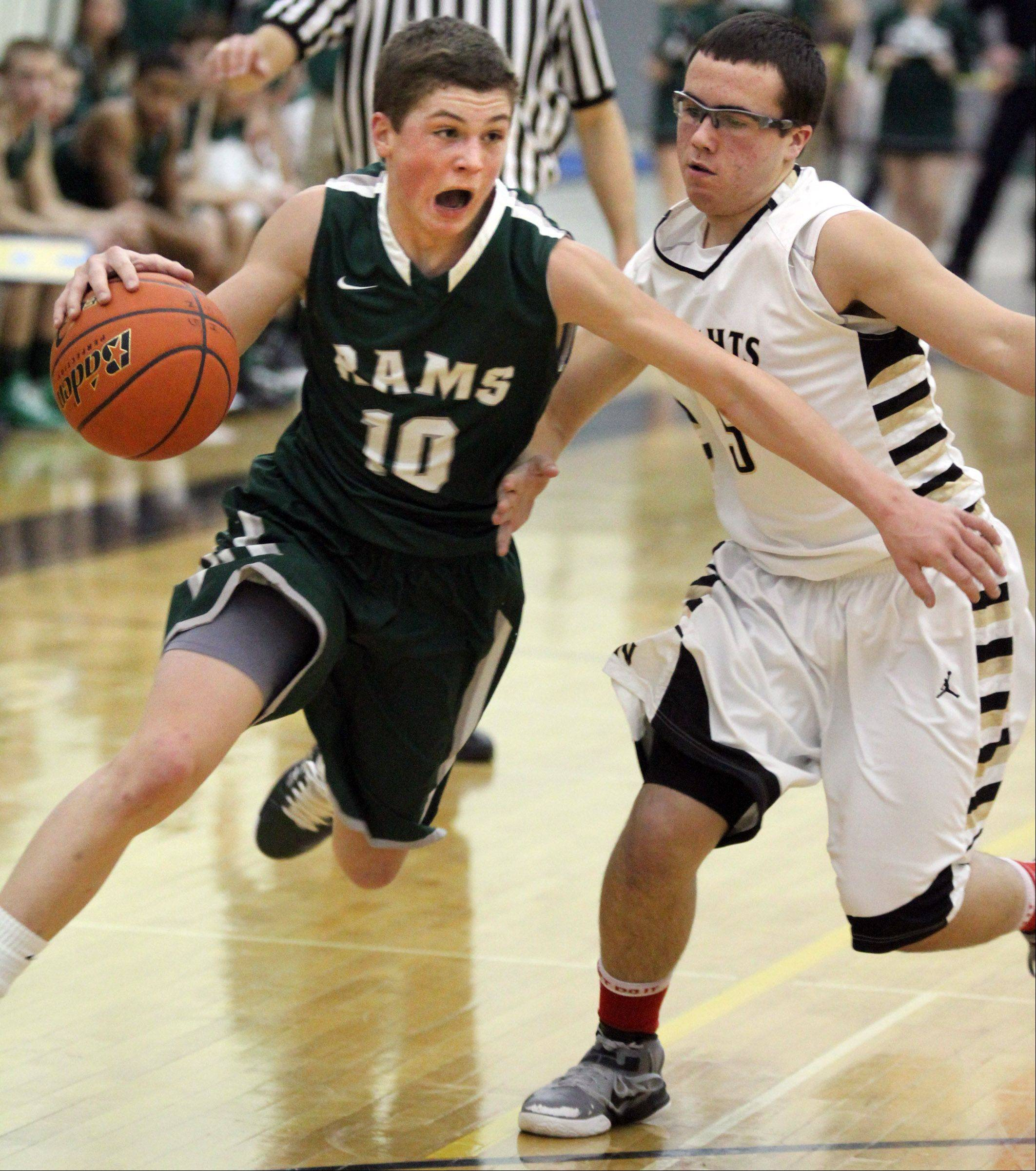 Grayslake Central guard Joey Mudd turns the corner on Grayslake North defender Matt Taskovic.