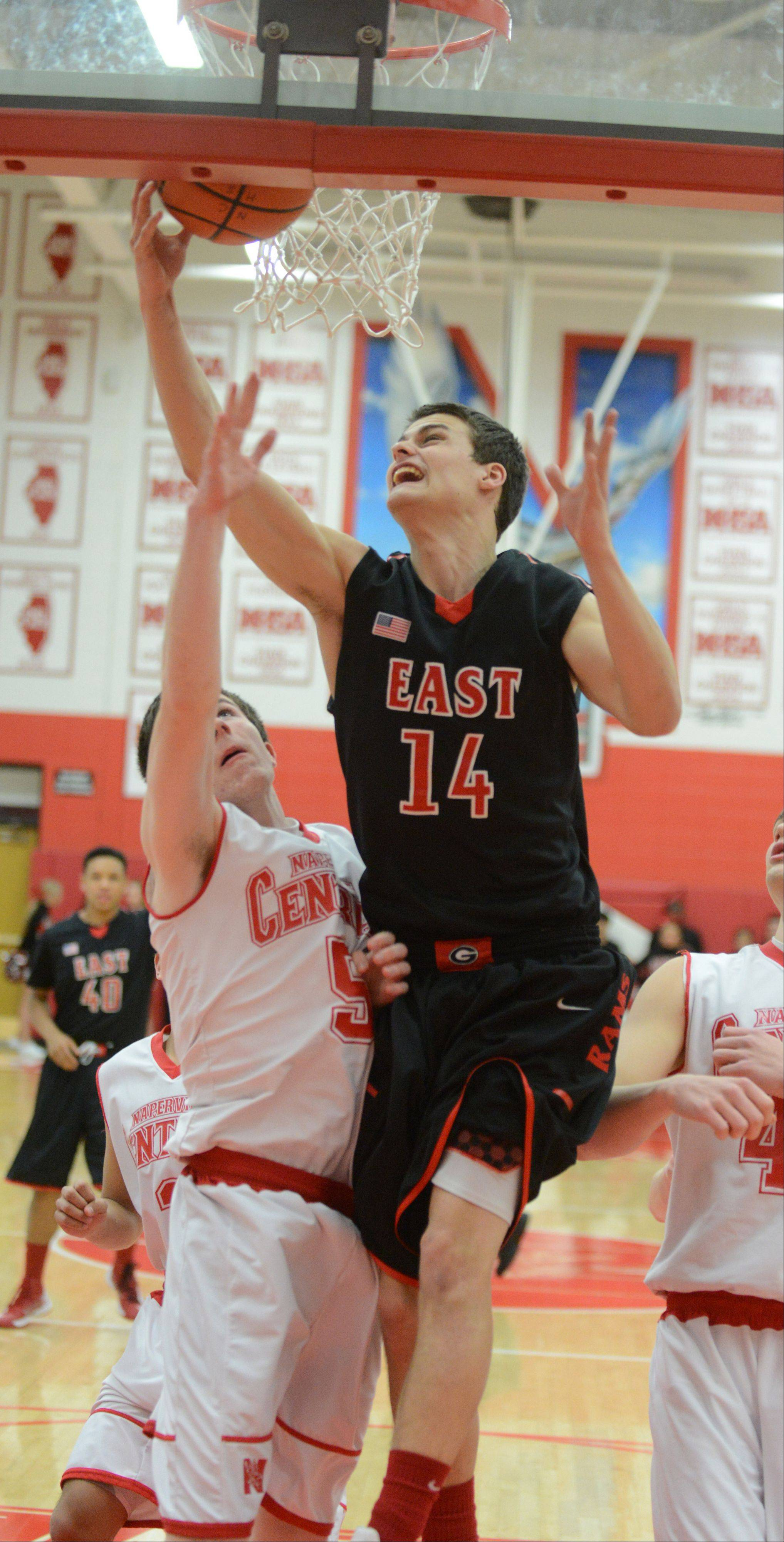 Rob Suntken of Naperville Central,left, and Mike Kjeldsen of Glenbard East go up for the ball.