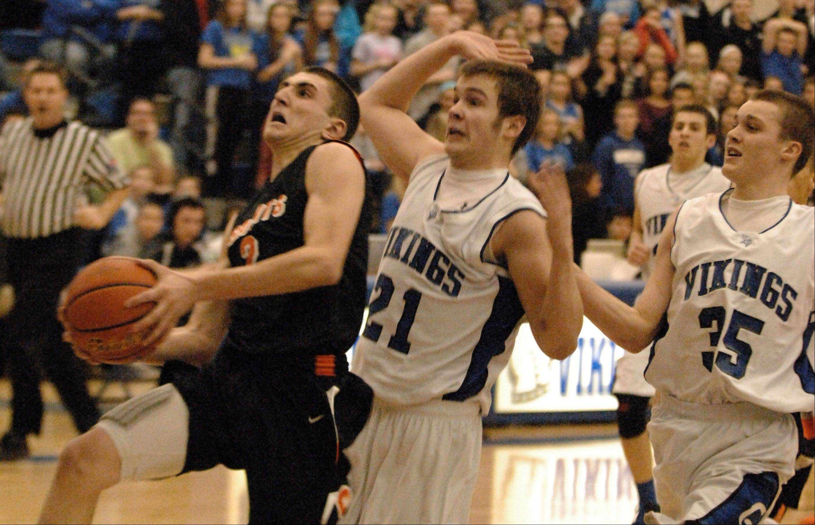 Images from the Geneva vs. St. Charles East boys basketball game Friday, January 24, 2013.