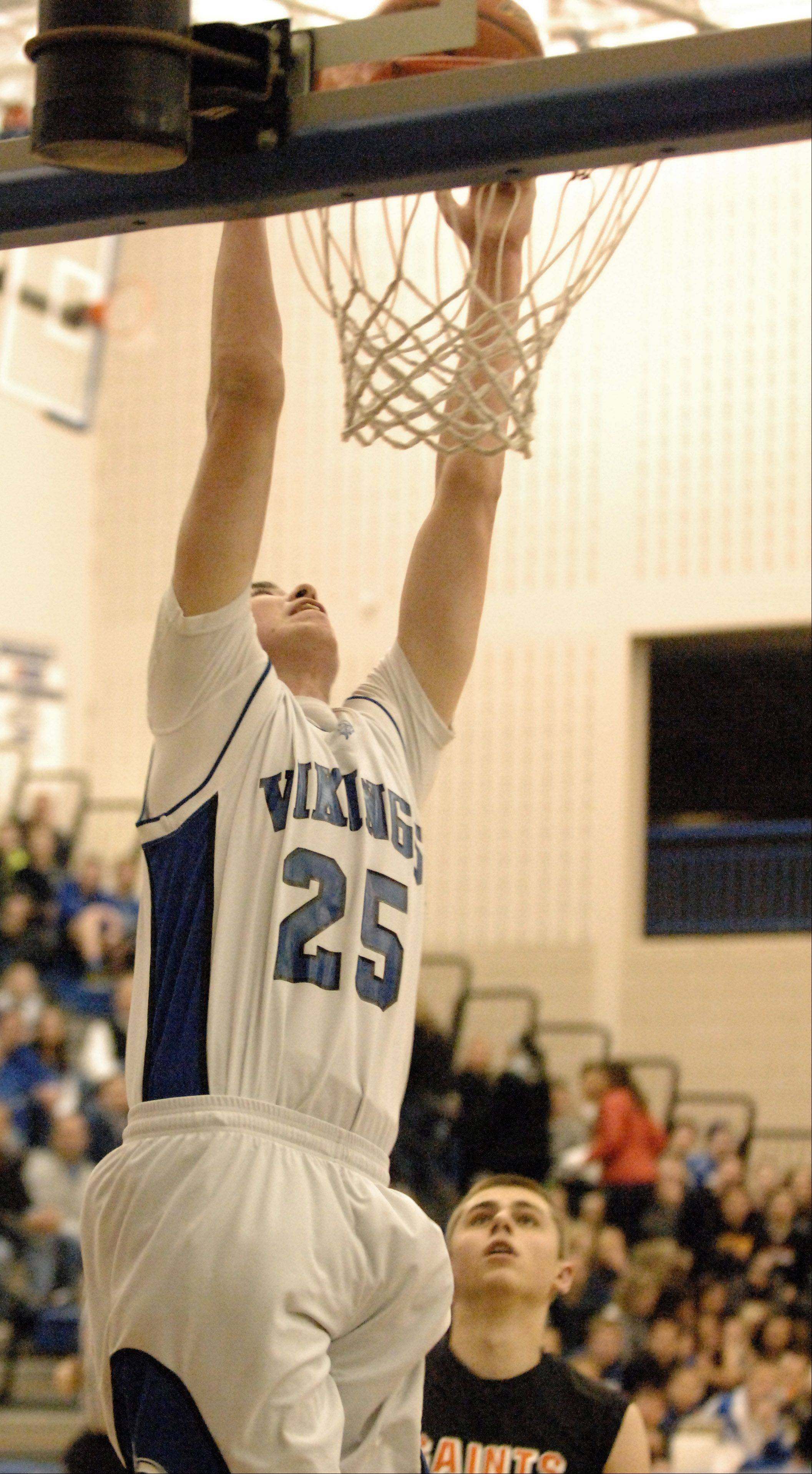 Geneva's Nate Navigato dunks on a fast break against St. Charles East.