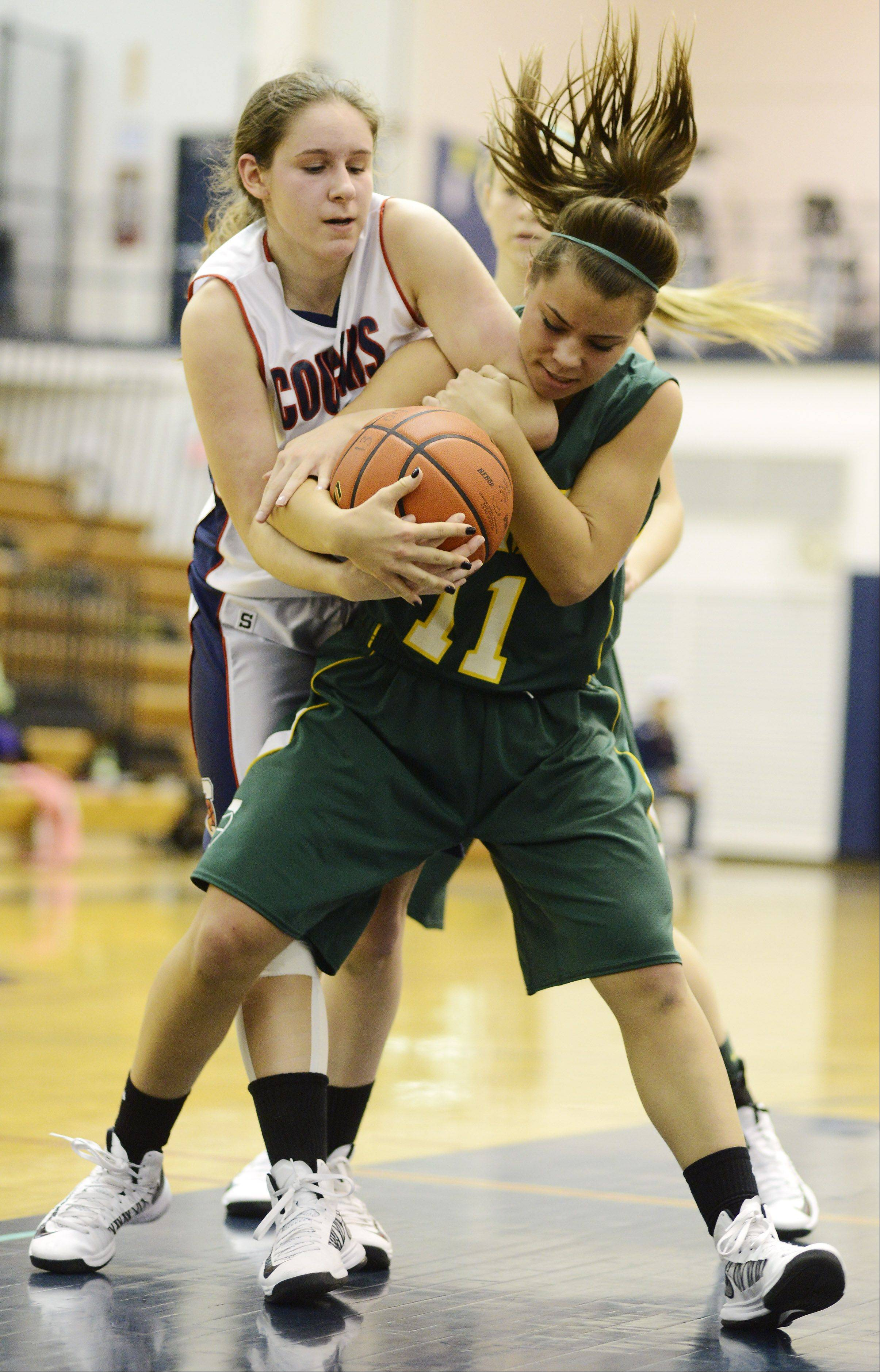 Conant's Sarah Mazurek, left, and Fremd's Catherine Ernst battle for possession during Tuesday's game.