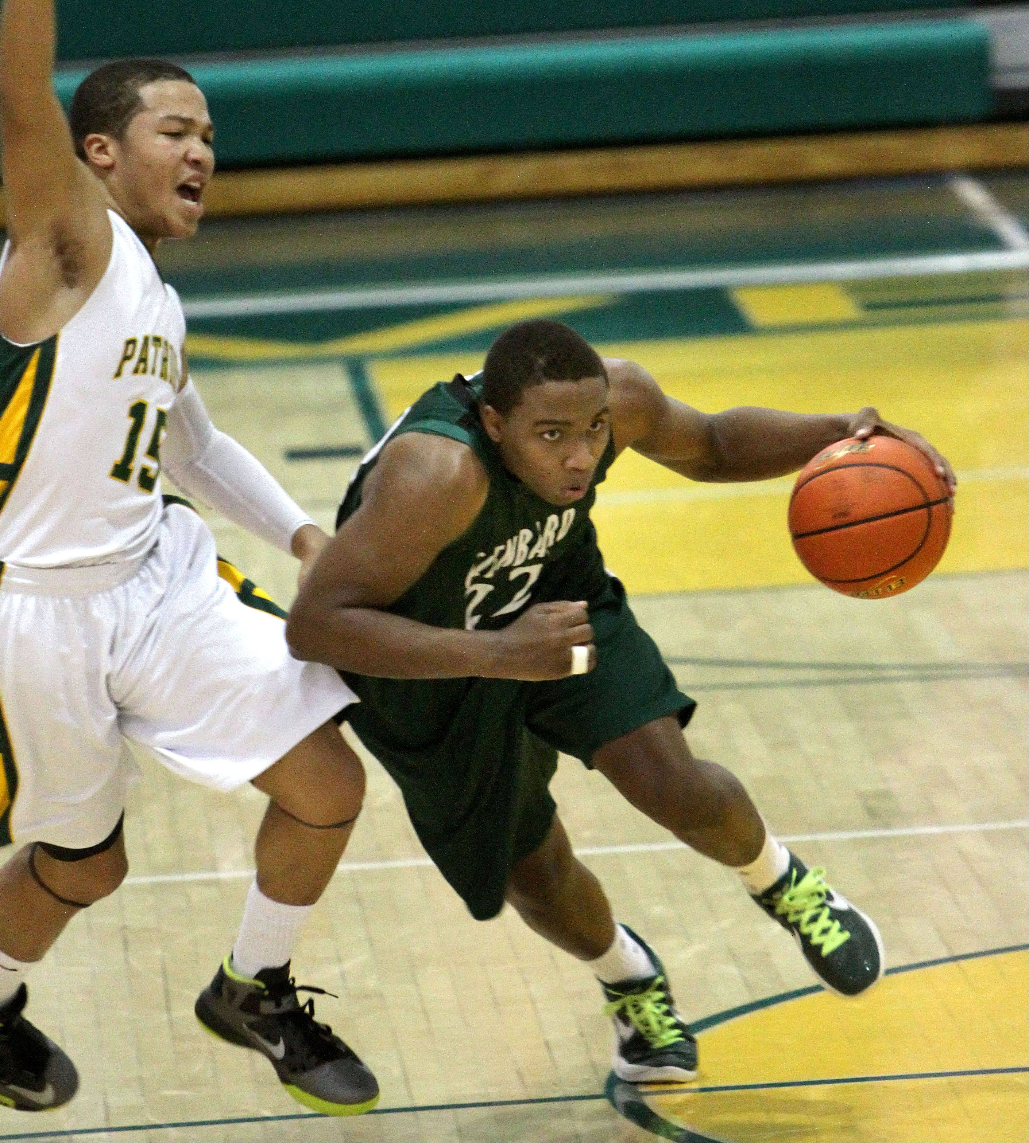 Glenbard West's Dikiria Washington, right, drives on Stevenson's Jalen Brunson.