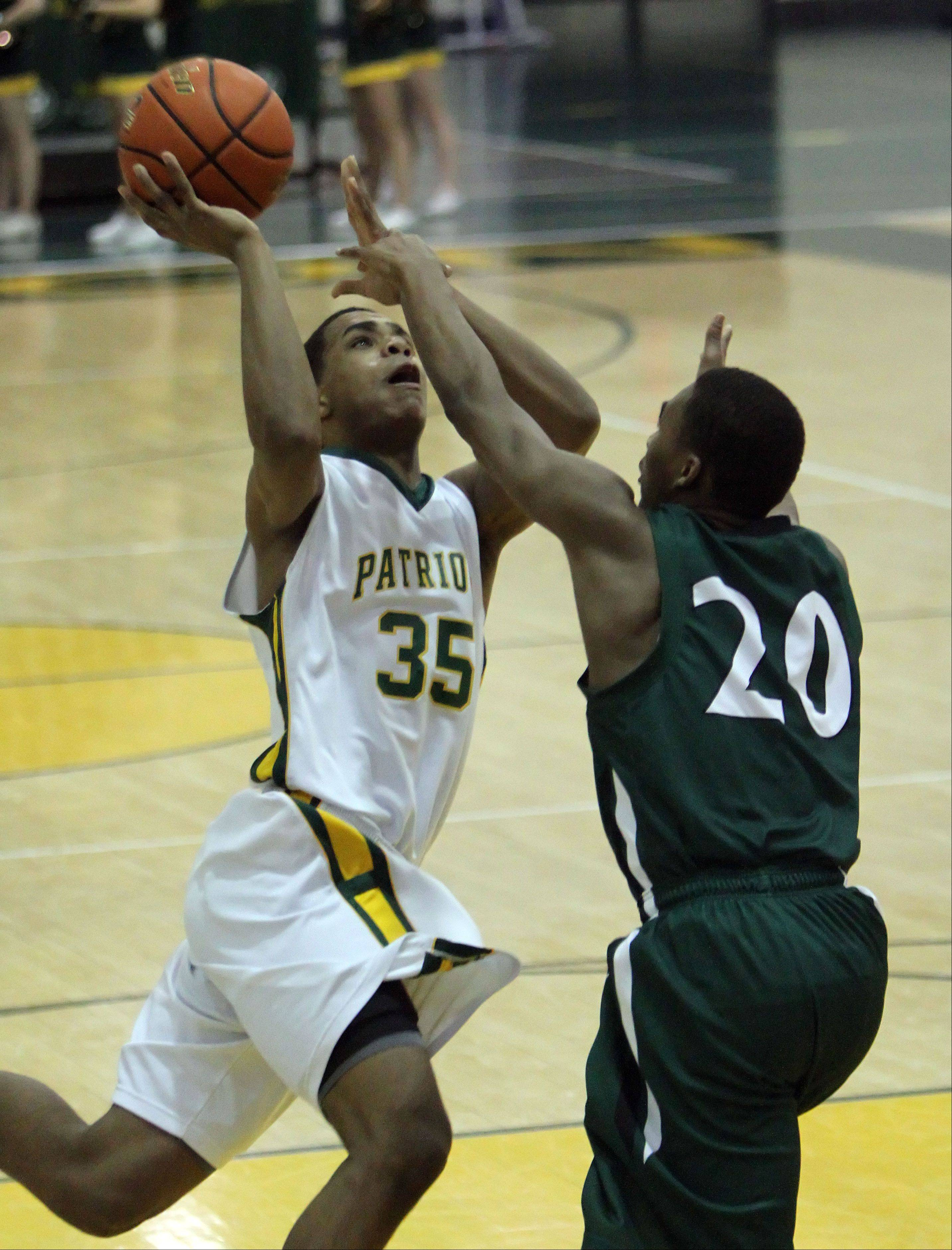 Stevenson's Connor Cashaw, left, drives on Glenbard West's Corey Davis.