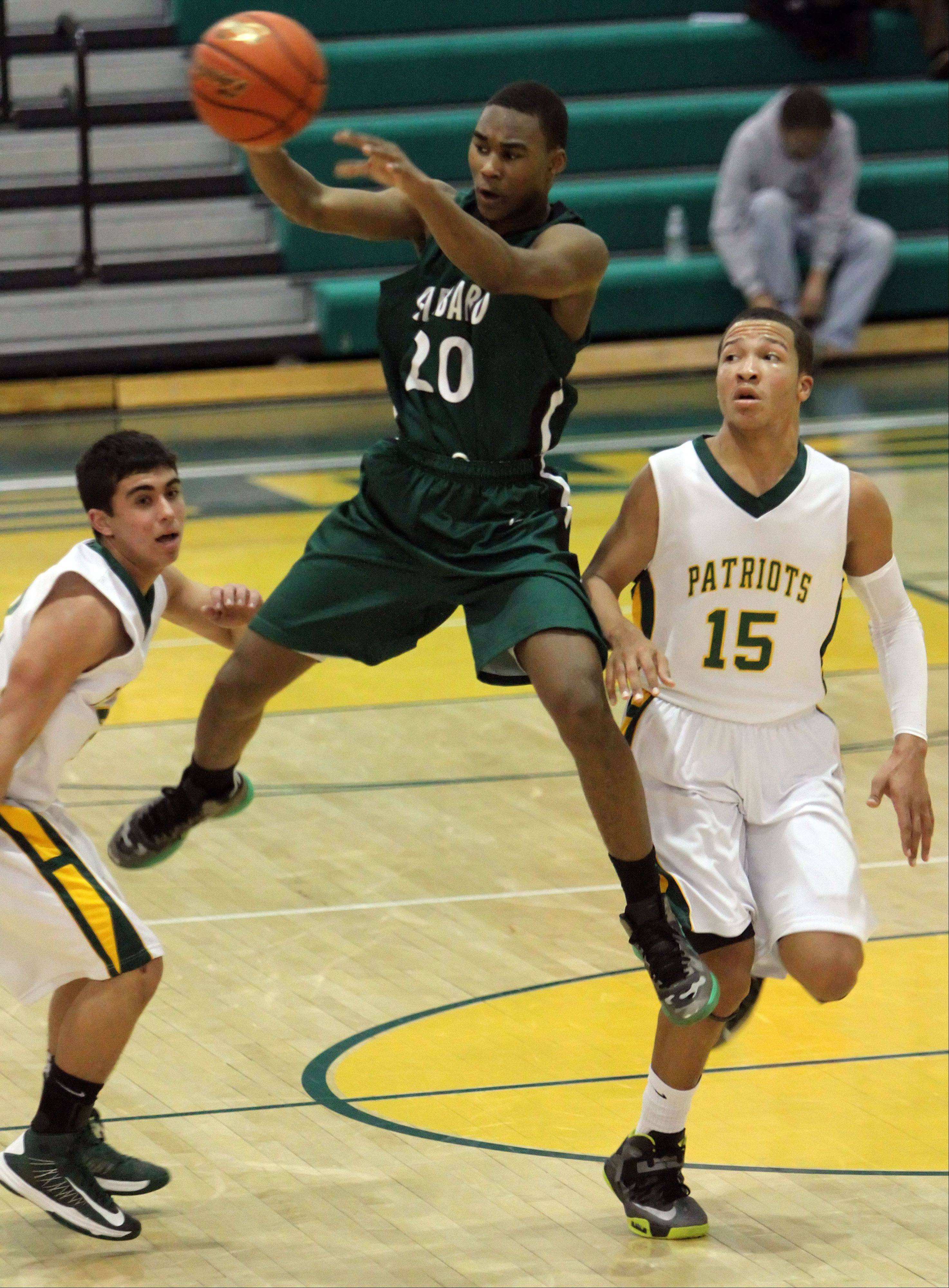 Glenbard West's Corey Davis passes with Stevenson's Justin Berkson, left, and Jalen Brunson defending.