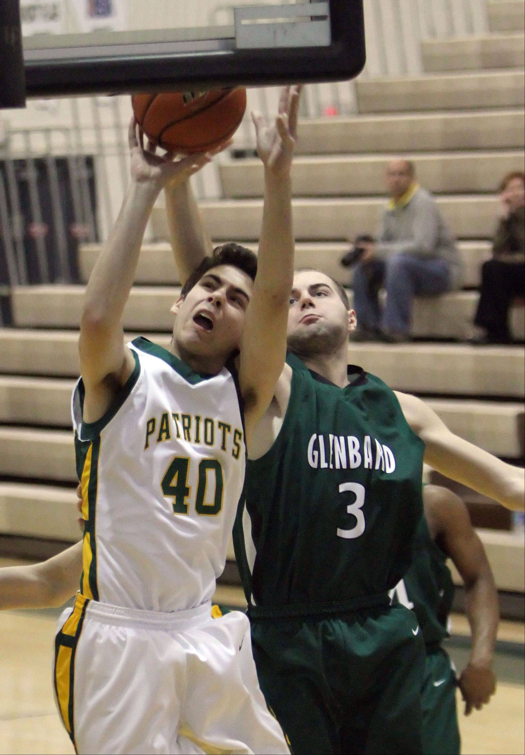 Stevenson's Parker Nichols,left, drives on Glenbard West's Kyle Bos.