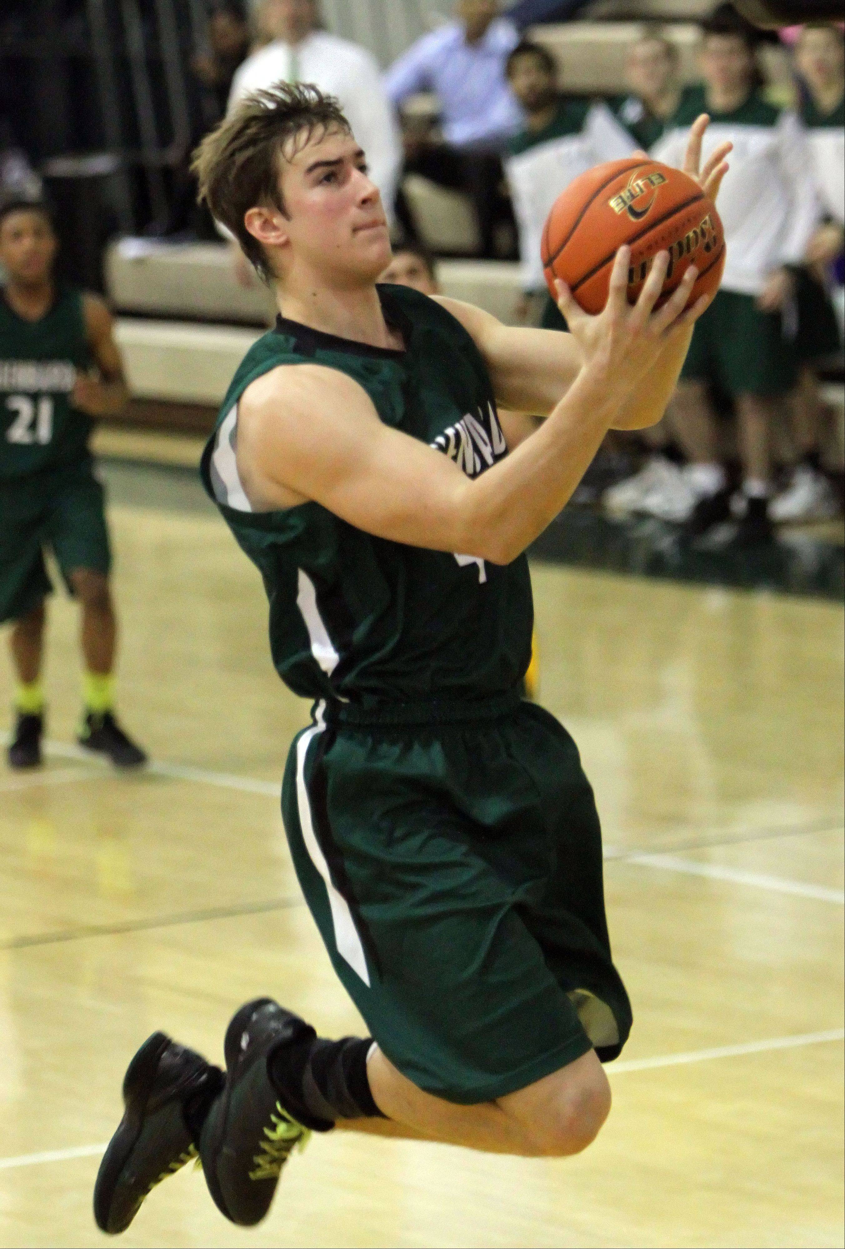 Glenbard West's Nathan Marcus drives to the hoop.