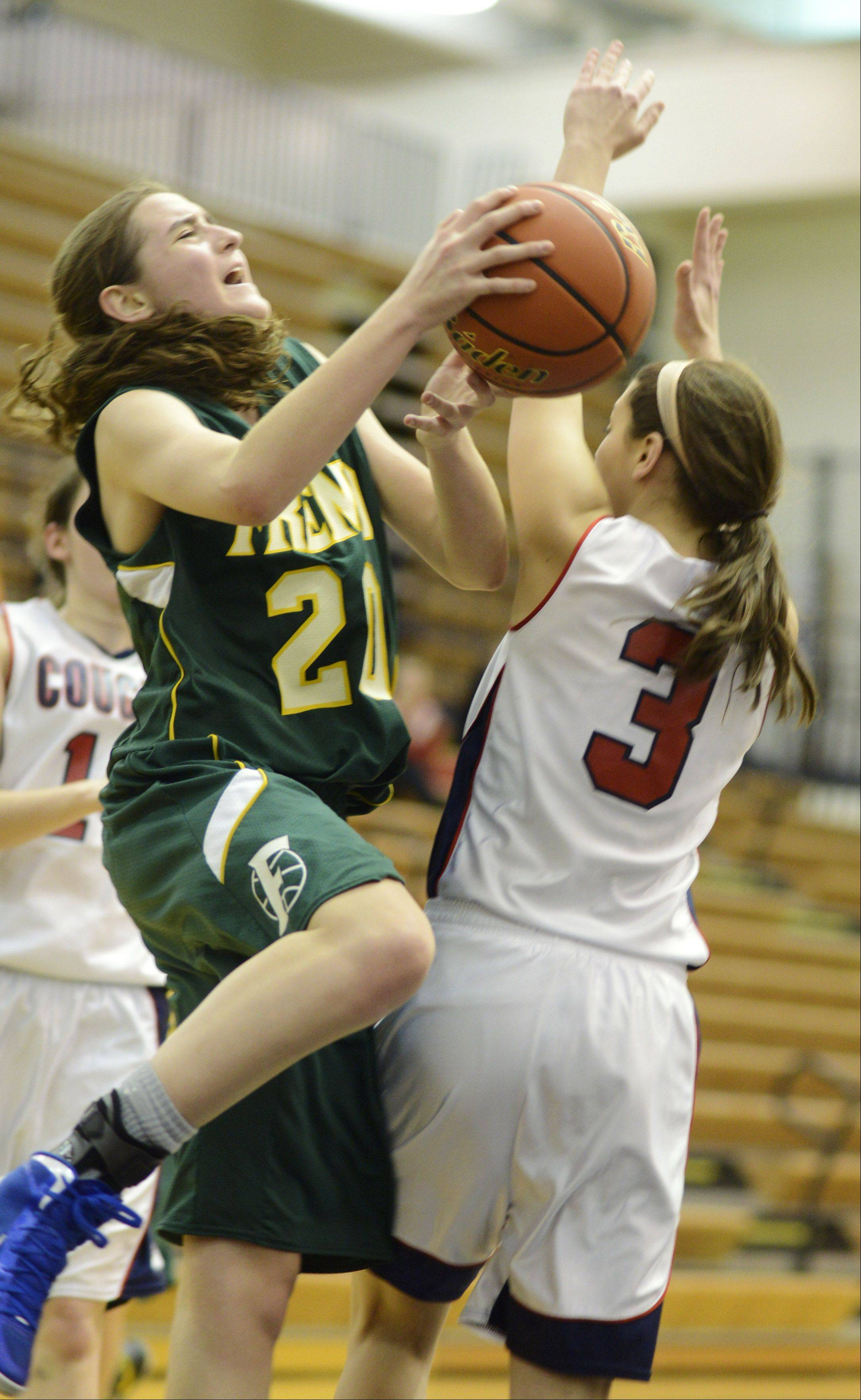 Fremd's Haley Gorecki, left, makes contact with Conant's DeeDee Durr.