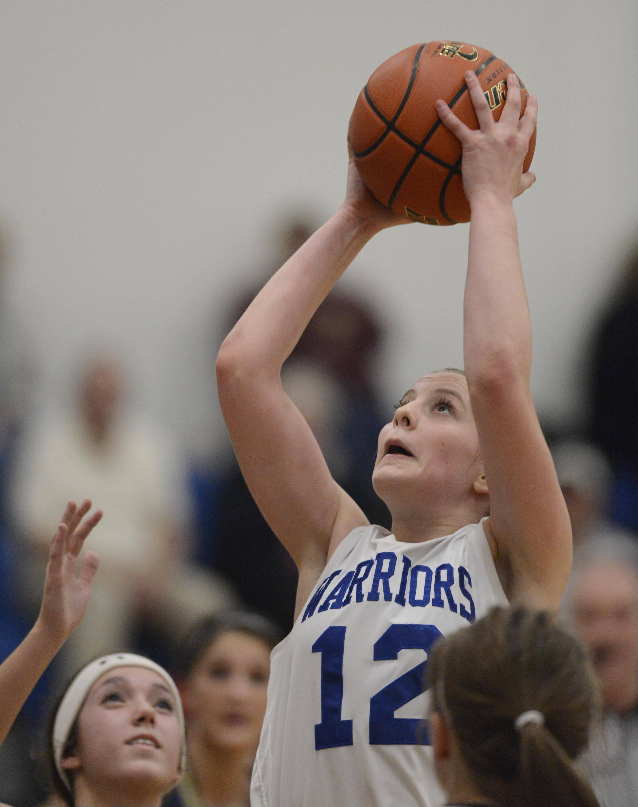 Westminster Christian's Maddie Versluys goes up for a score against Ottawa Marquette Academy Tuesday in Elgin.