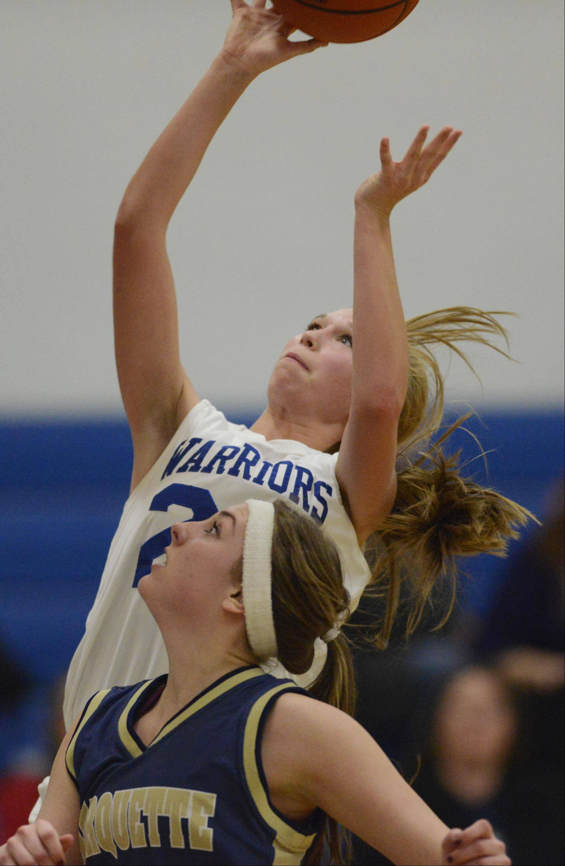 Westminster Christian's Kinsley Donahue lays up a basket against Ottawa Marquette Academy Tuesday in Elgin.