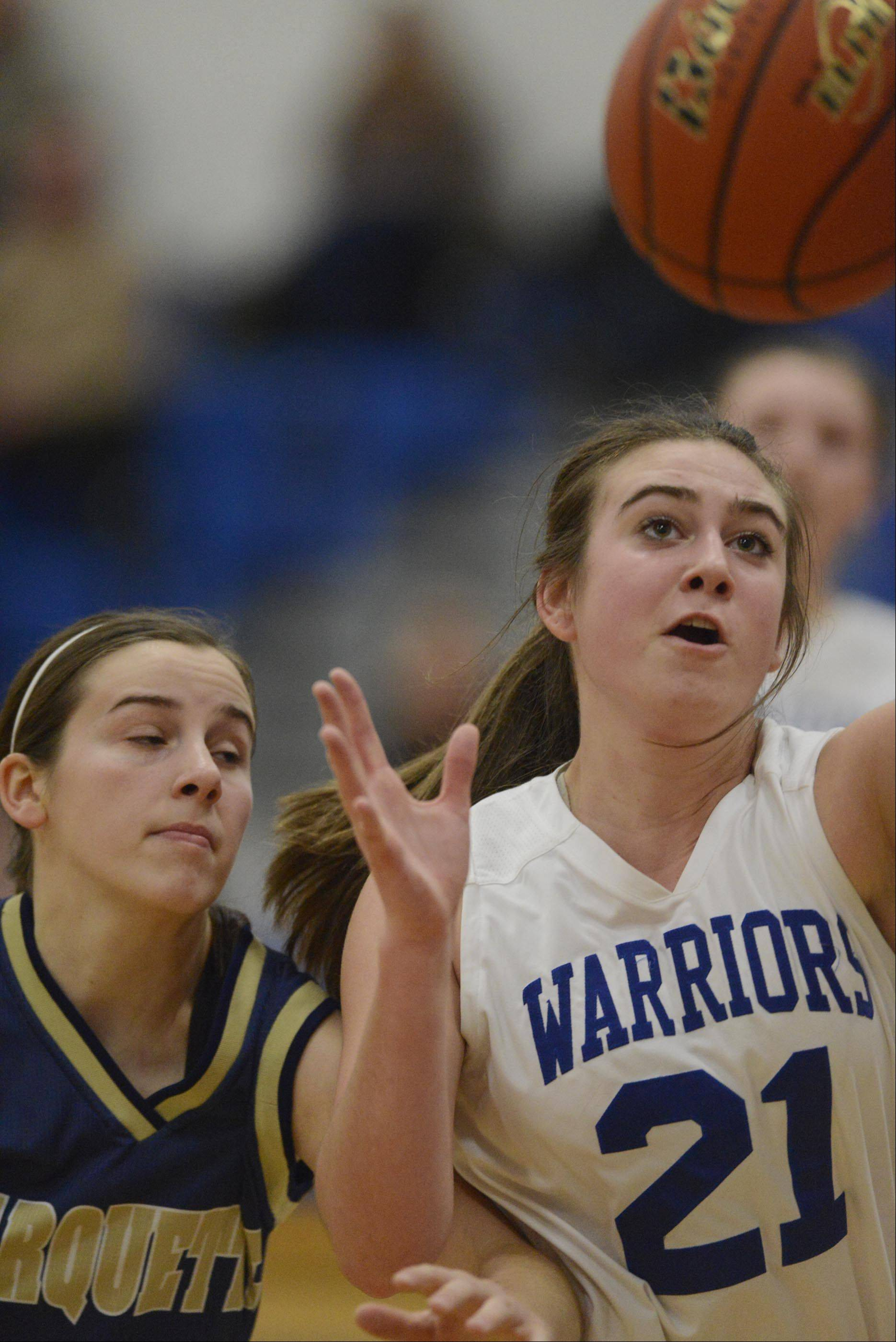 Westminster Christian's Libbie Atchison gets to a rebound before Ottawa Marquette Academy's Kendall Kaufmann.