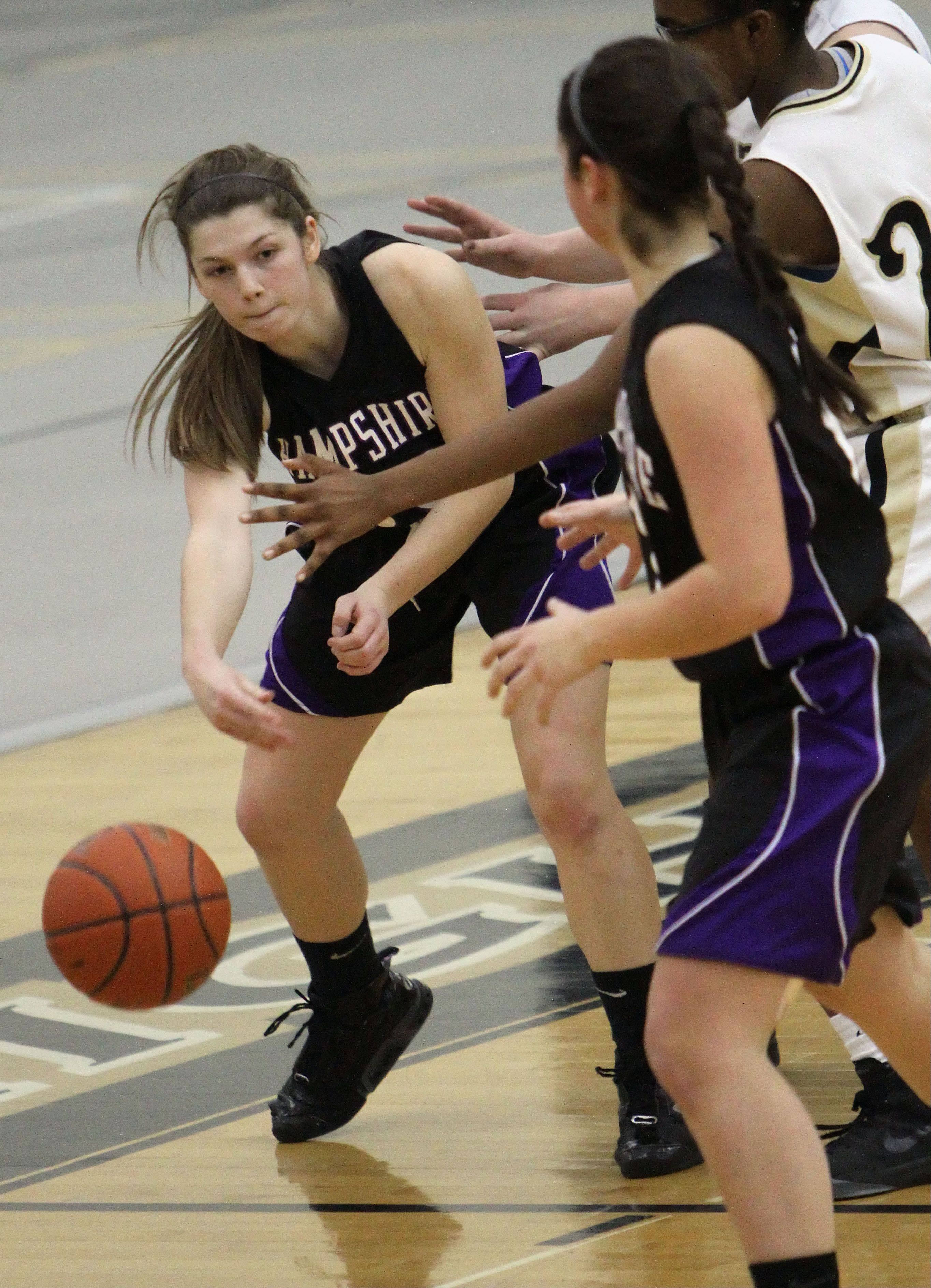 Hampshire's Tricia Dumoulin, left, passes to Becky Dumoulin on Wednesday night at Grayslake North.