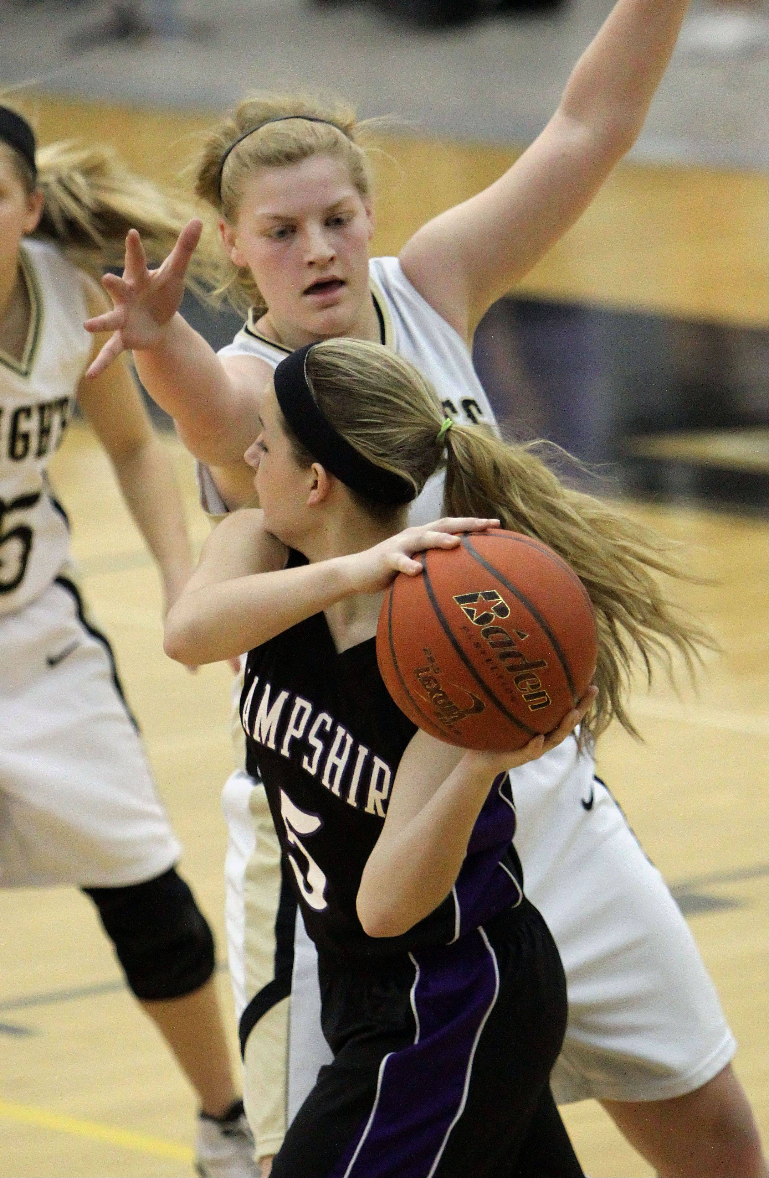 Grayslake North's Joanna Guhl guards Hampshire's Sara Finn on Wednesday night at Grayslake North.