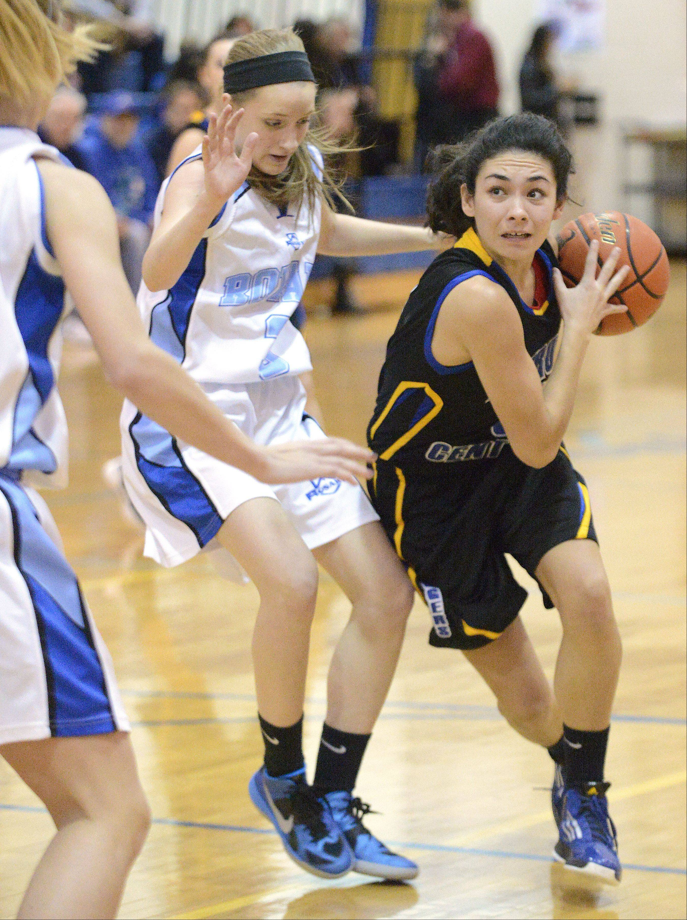 Aurora Central Catholic's Lisa Rodriguez pushes past Rosary's Rachel Choice as she drives for the hoop in the first quarter.