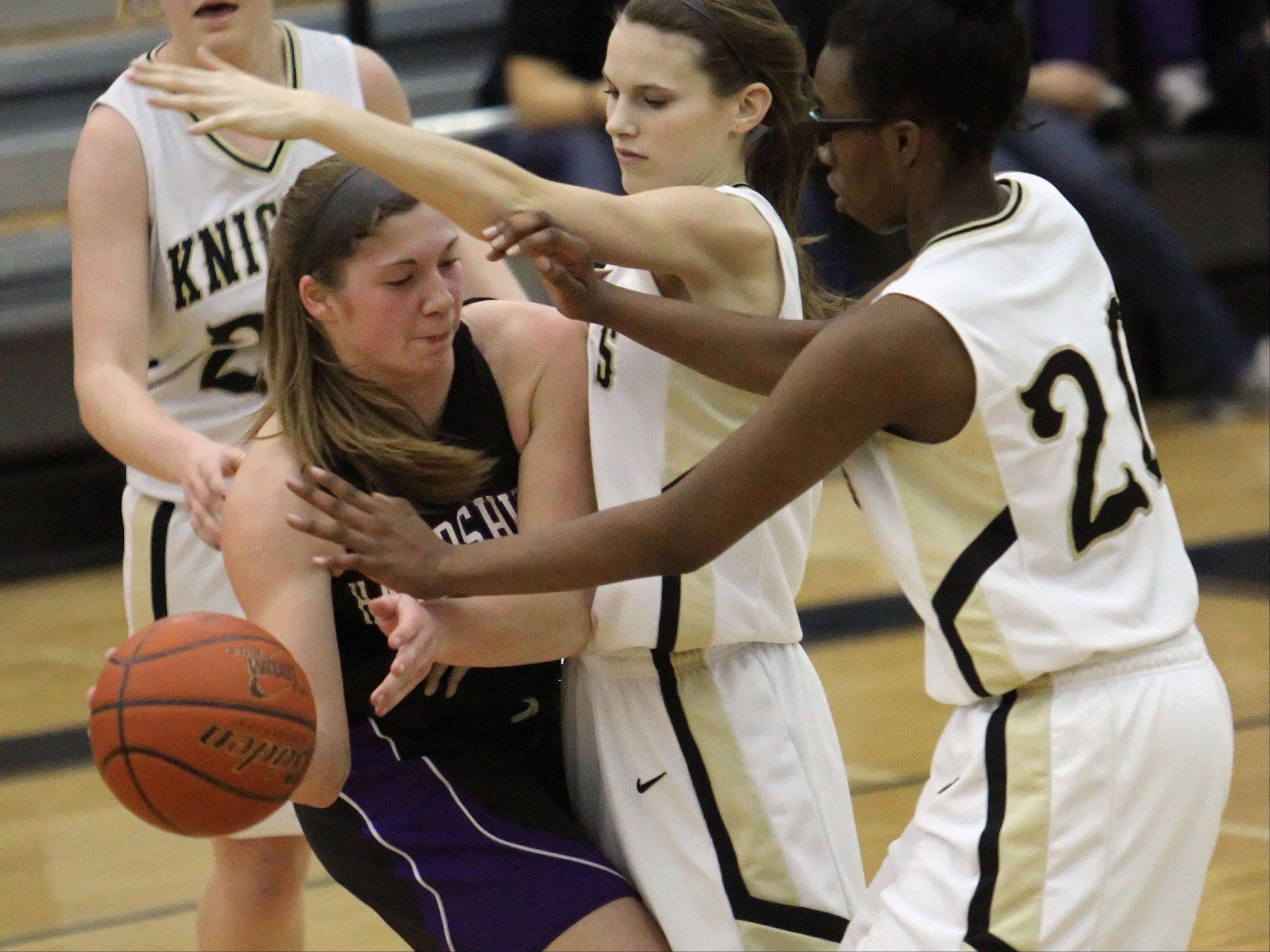 Grayslake North's Maggie Fish and Brittany Thibeaux, right, guard Hampshire's Jen Dumoulin.