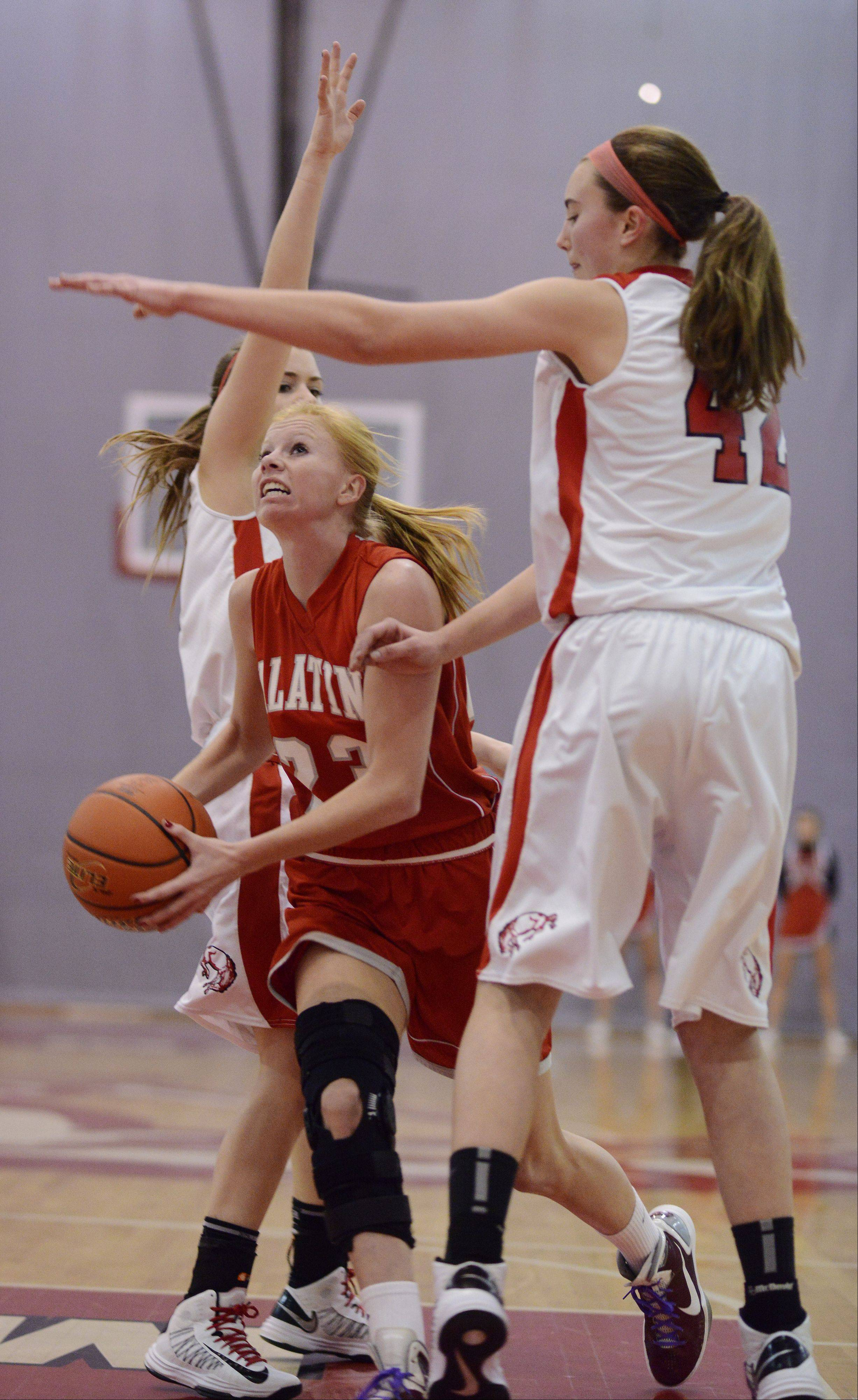 Palatine's McKenzie Wiedemann tries to get past Barrington's Megan Talbot earlier this season. Palatine has been bamed the Chicago Sky Girls High Schooll Basketball Team of the Week.