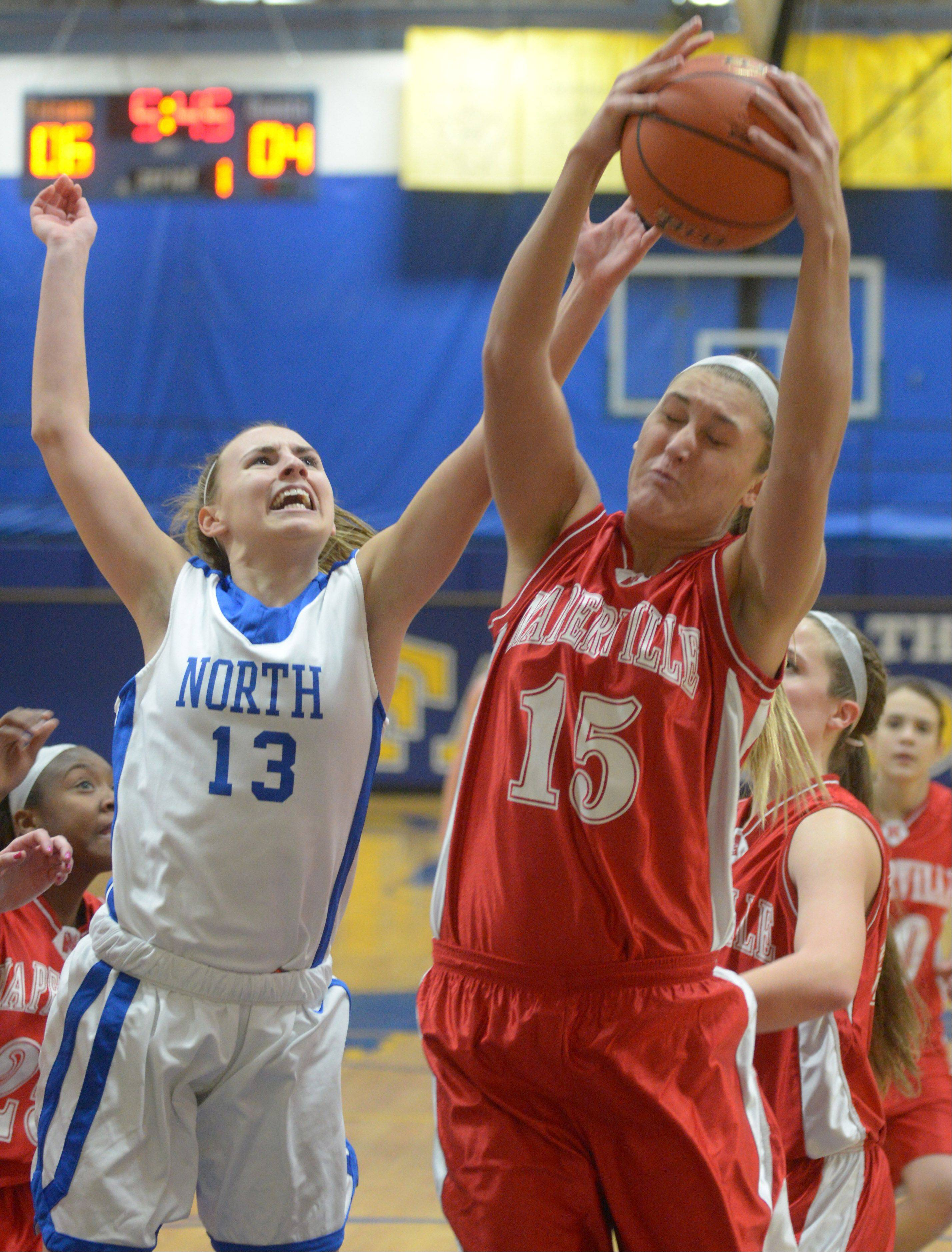 Brooke Schanowski of Wheaton North tries to block Victoria Trowbridge of Naperville Central during the Naperville Central at Wheaton North Girls basketball game Thursday.