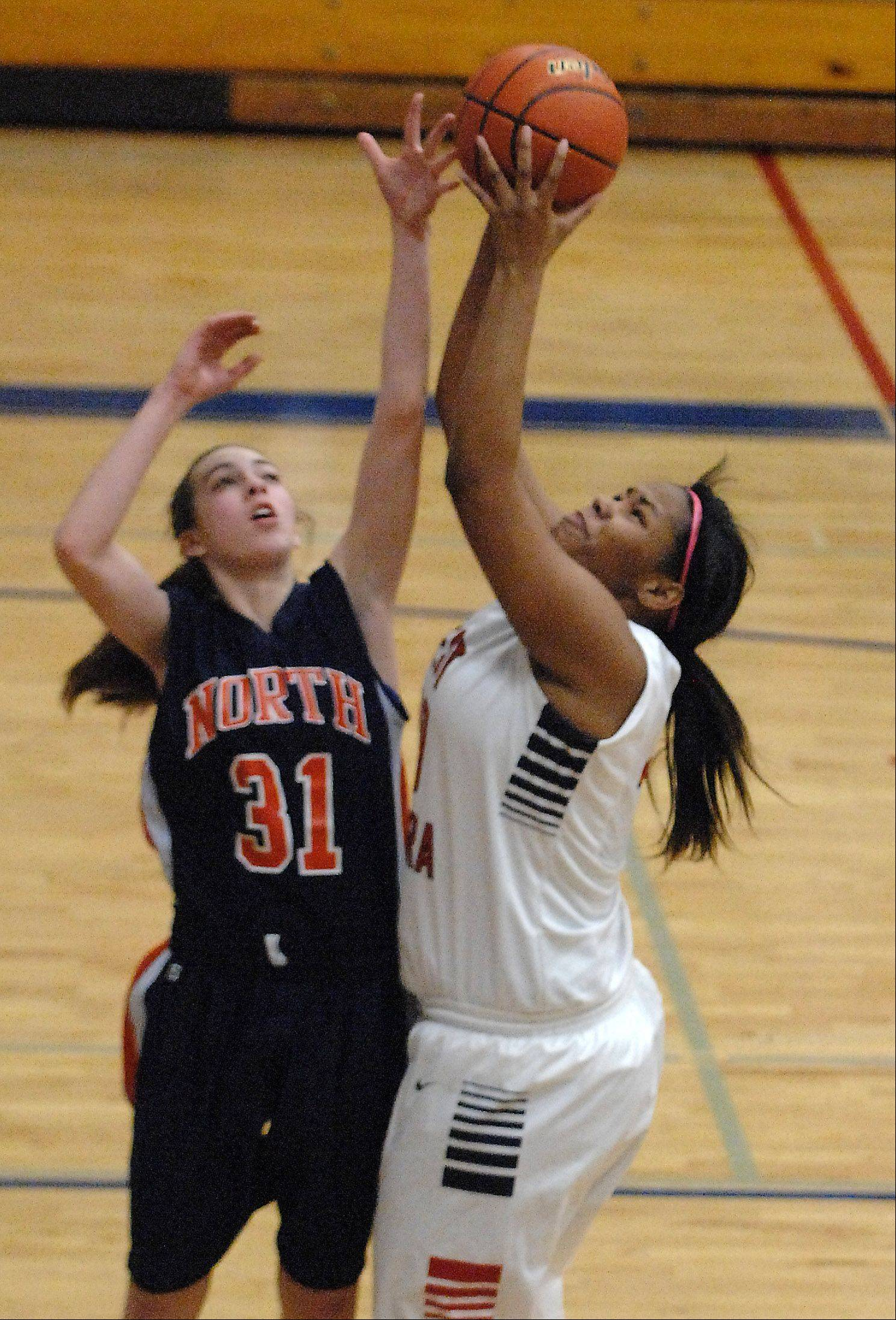 West Aurora's Kyler Robinson shoots over Naperville North's: aire; Pereira during Thursday's game in Aurora.