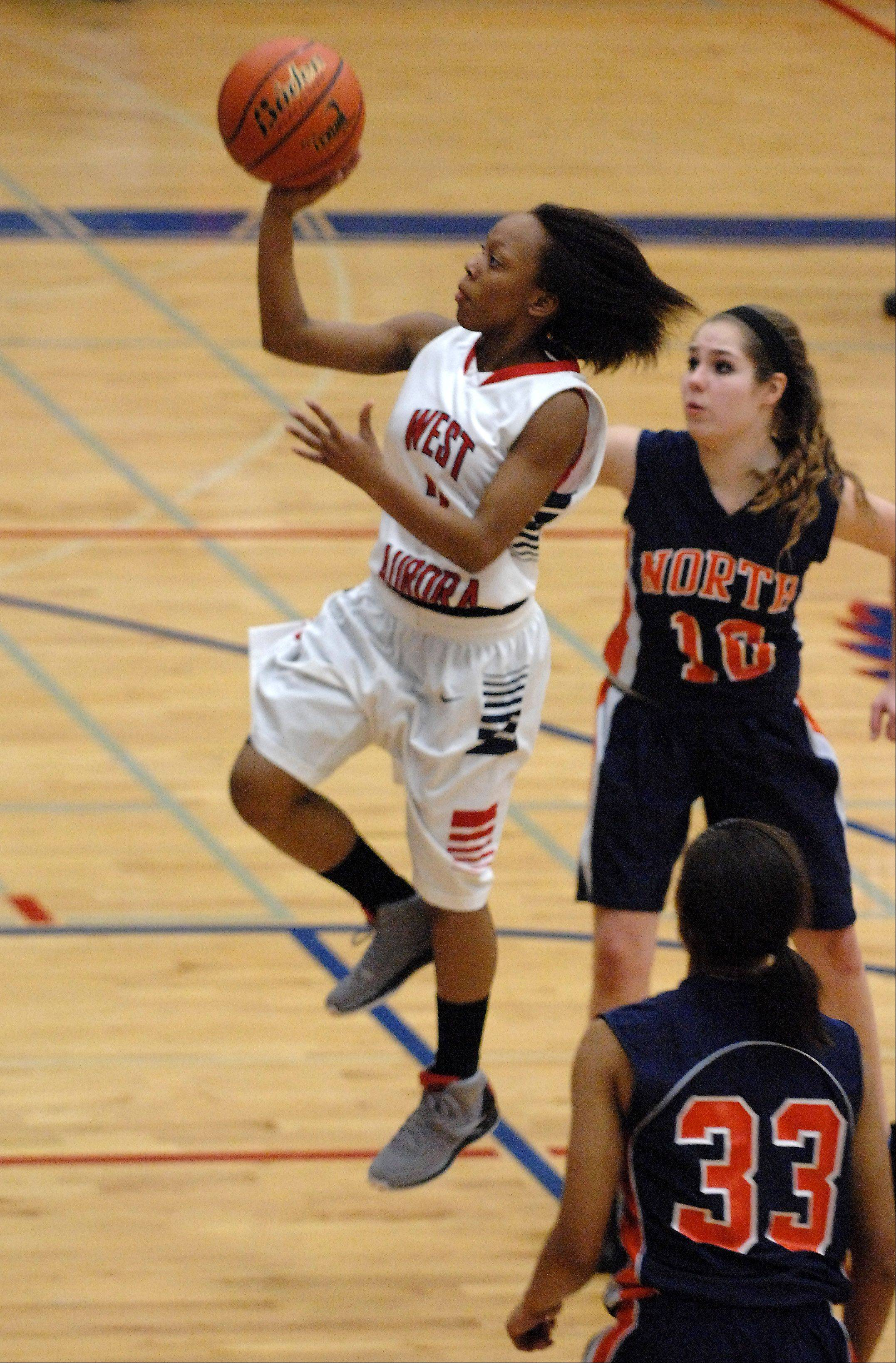 West Aurora's Alexis Wiggins pulls up with a running one-hander against Naperville North.