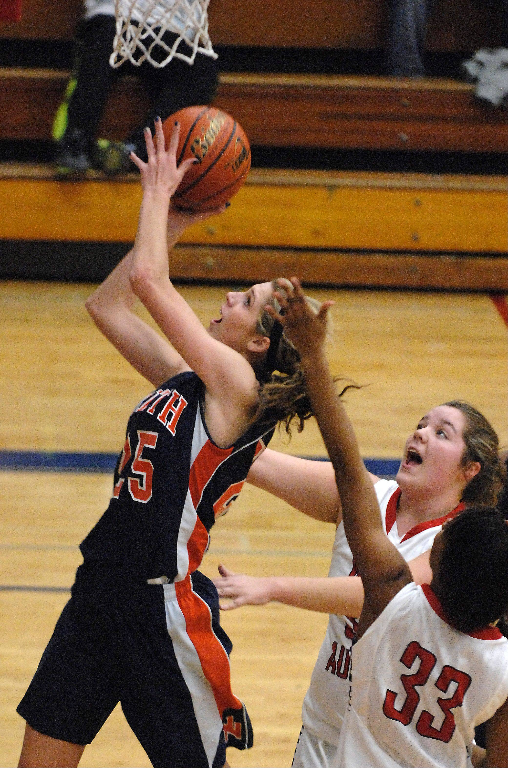 Naperville North's Kayla Sharples scores past two West Aurora defenders.