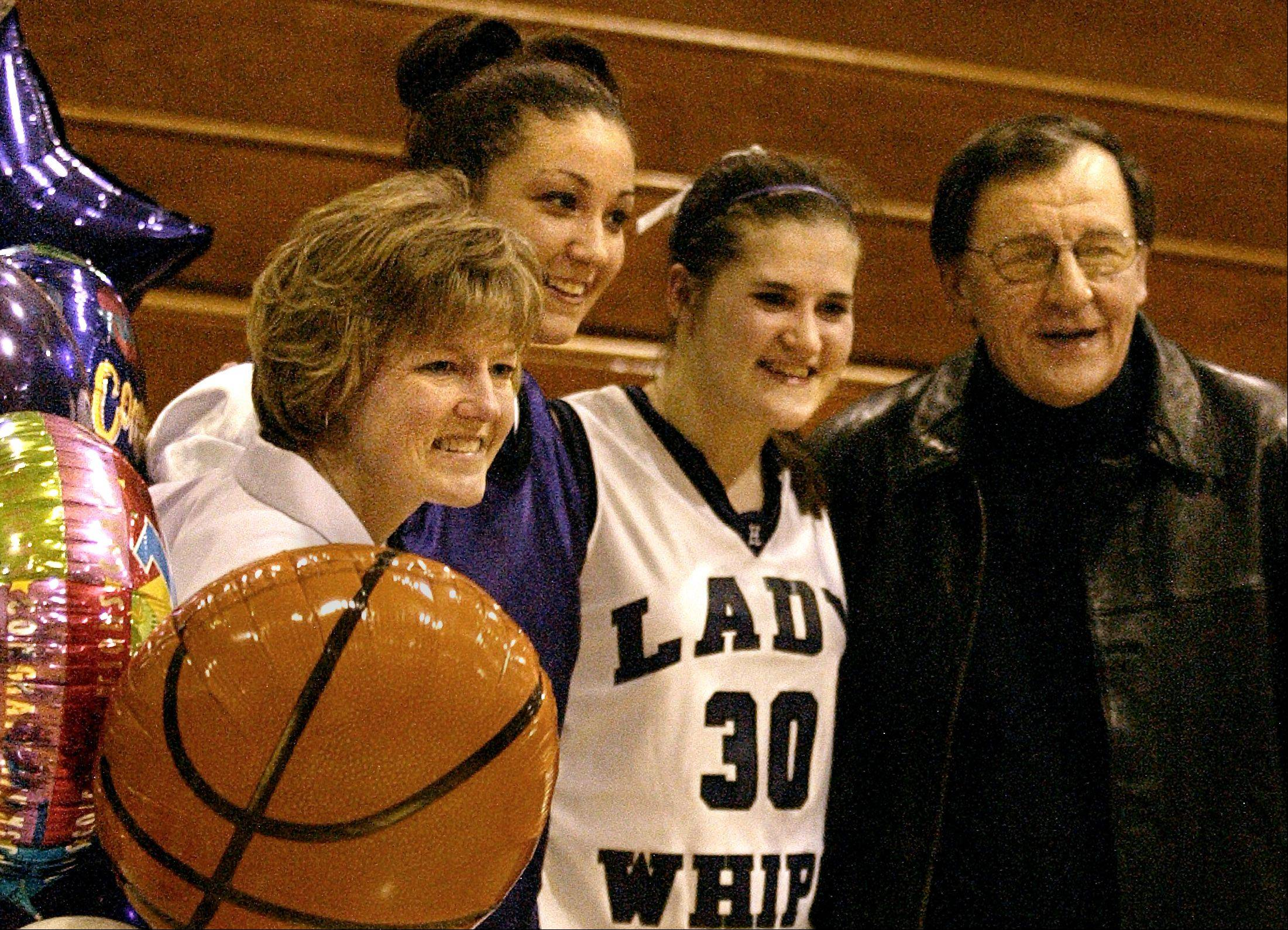 Former Hampshire girls basketball coaches Sue Ellett, left, and Milt Awe celebrate 1,000 career points scored by Nicole Watzlawick (center left) and Jackie Heine (center right) during a game in 2004. Later that season the Whip-Purs finished second in the Class A state tournament and Watzlawick and Heine were named Daily Herald all-area captains.