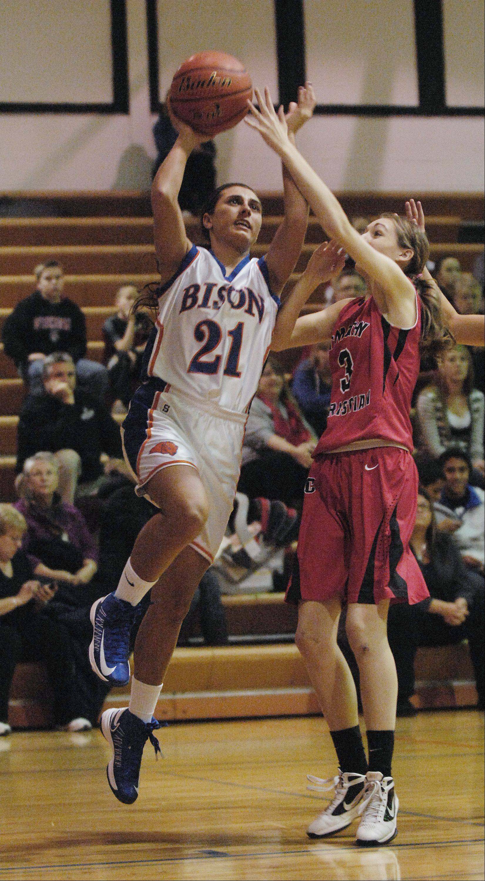 Rachael Leschewski of Fenton High School heads to the basket past Brittany Scheidt of Timothy Christian.