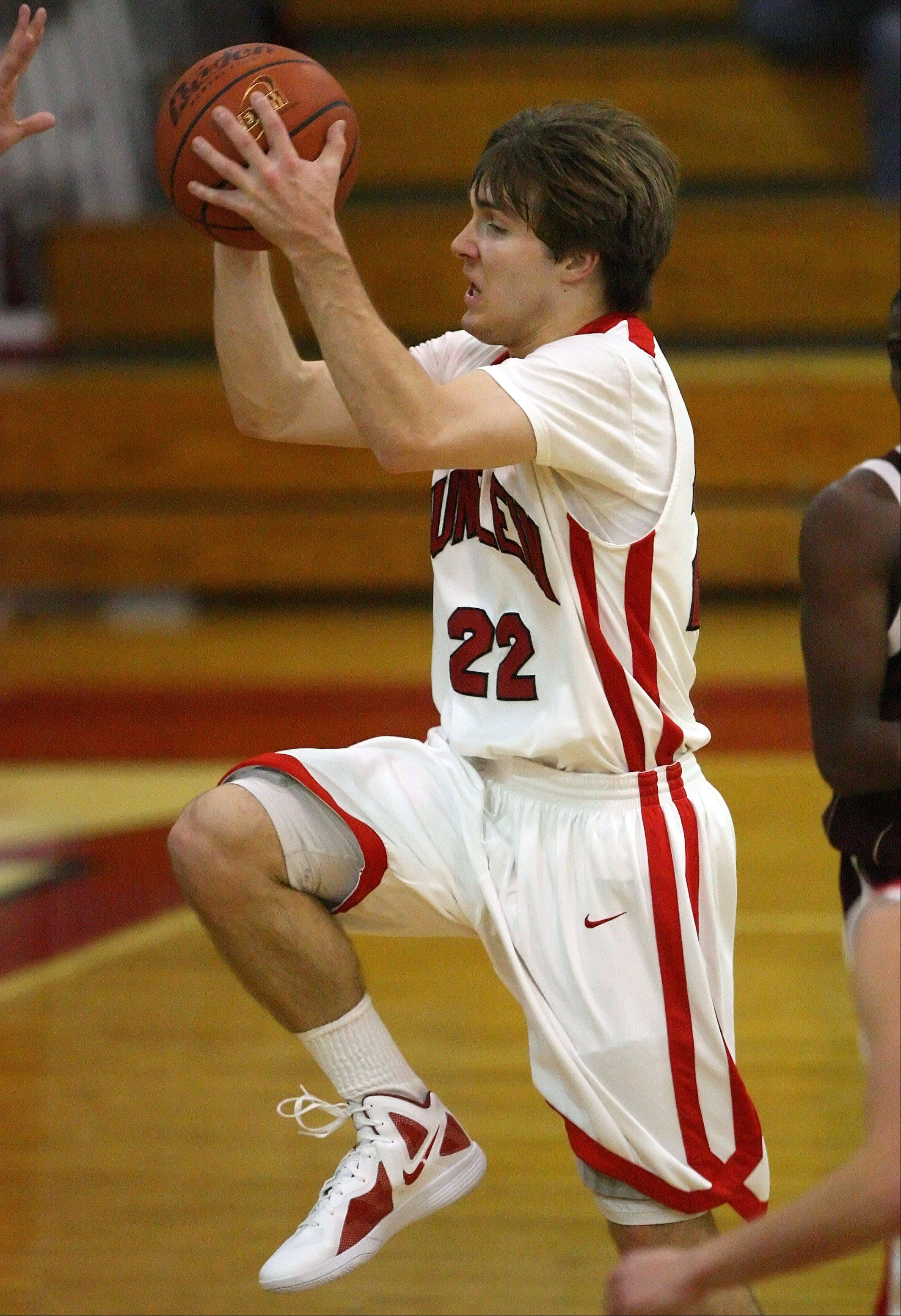 Mundelein's Robert Knar, here driving to the hoop last season, is back in action after what seemed like an interminable injury rehab.