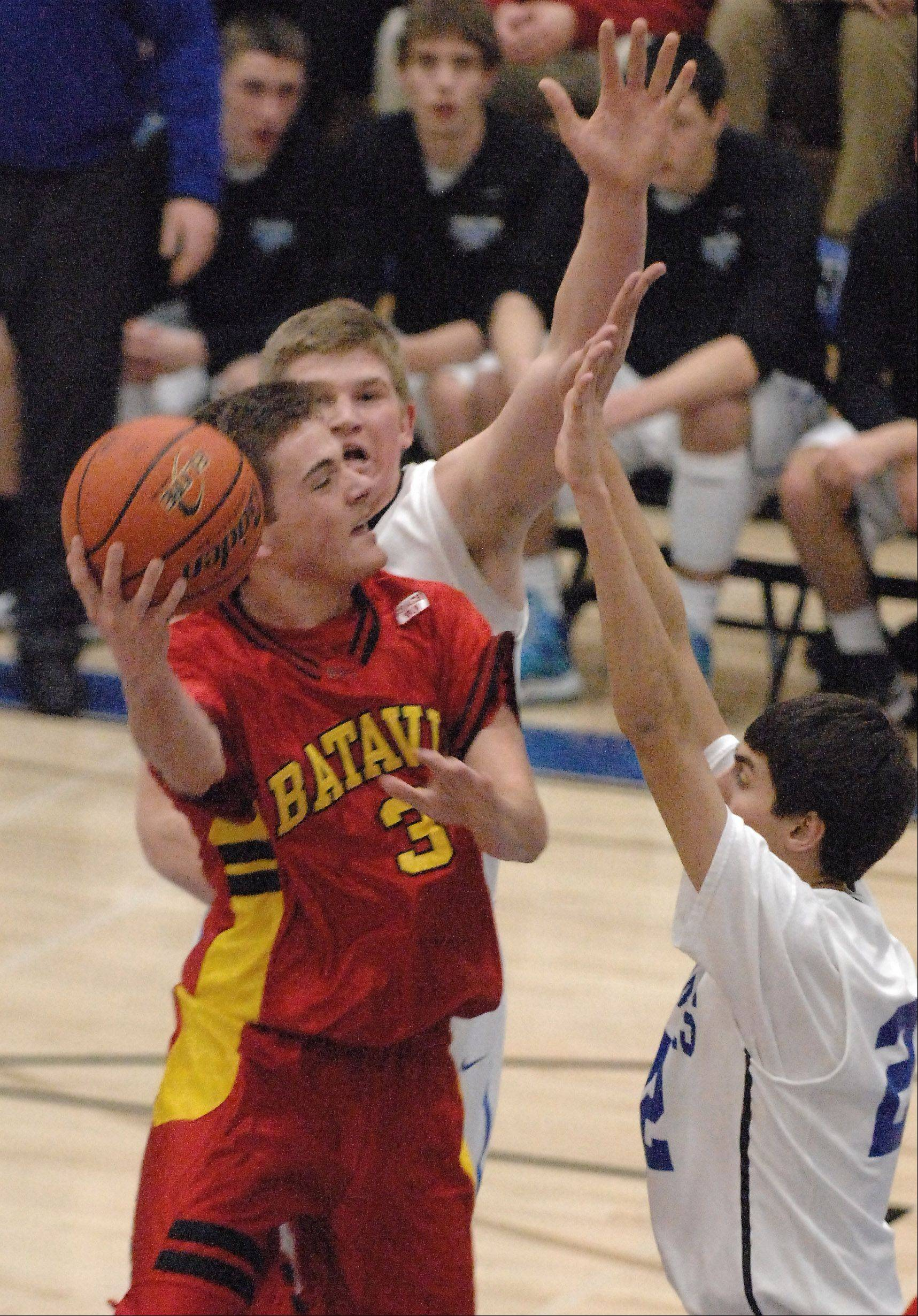 Batavia's Jake Pollack navigates a crowded lane as he tries to shoot against St. Charles North.