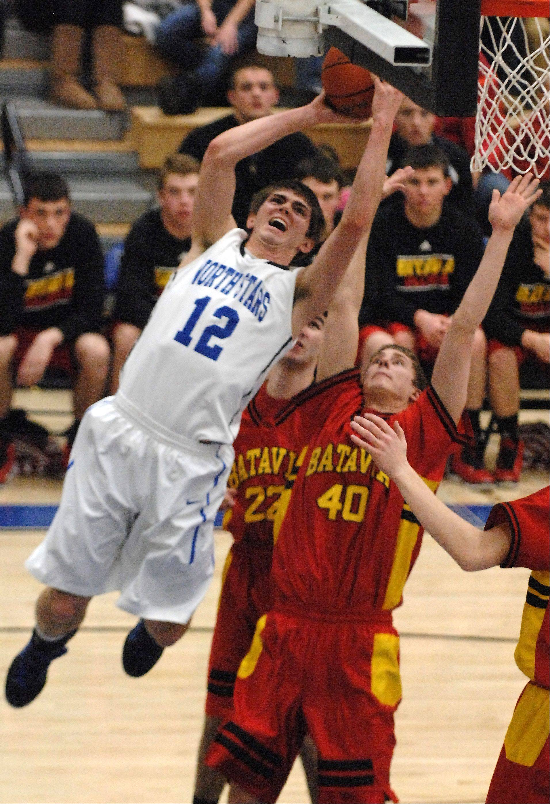 St. Charles North's Quinten Payne drives to the basket against Batavia.