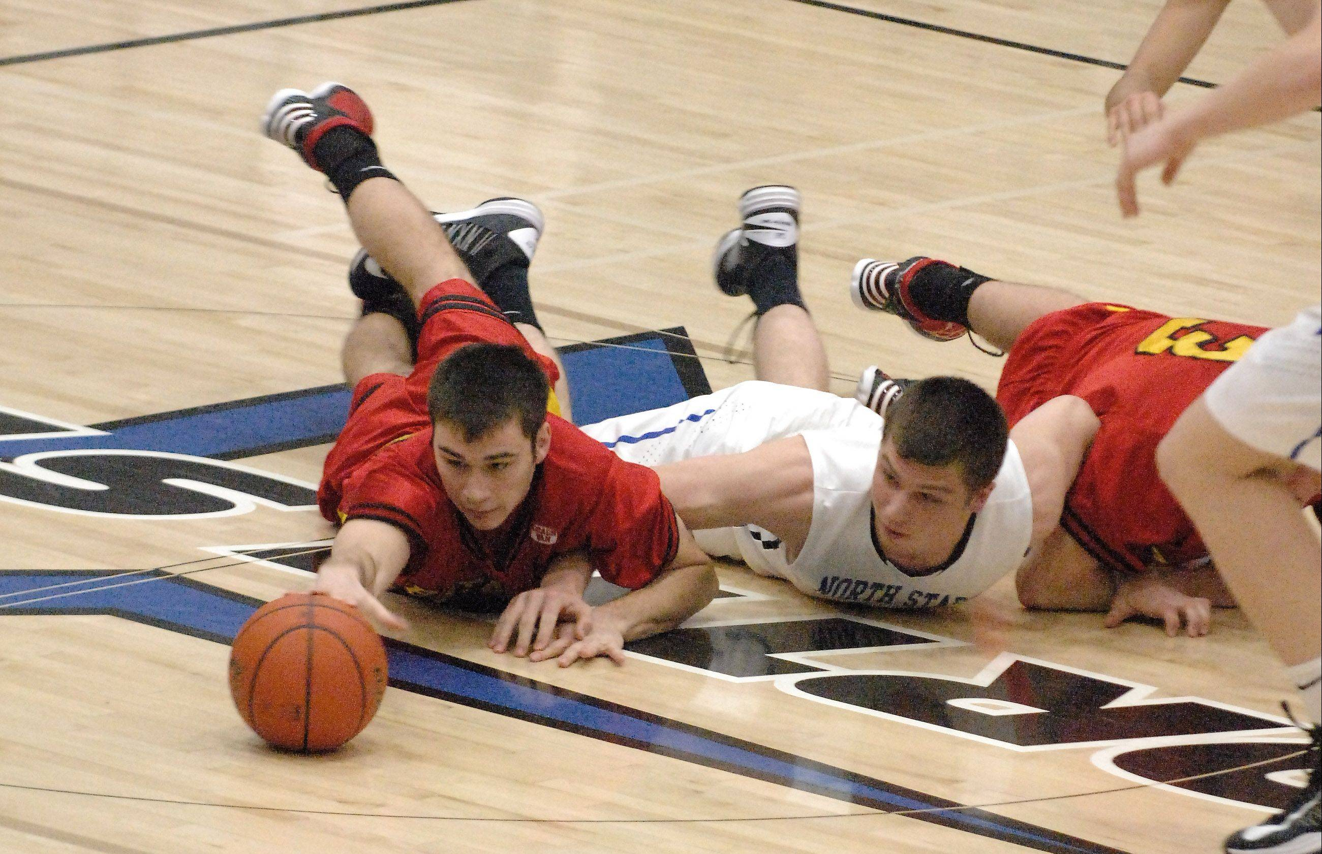 Batavia's Zach Strittmatter and St. Charles North's Ryan Thomas hit the deck for a loose ball.