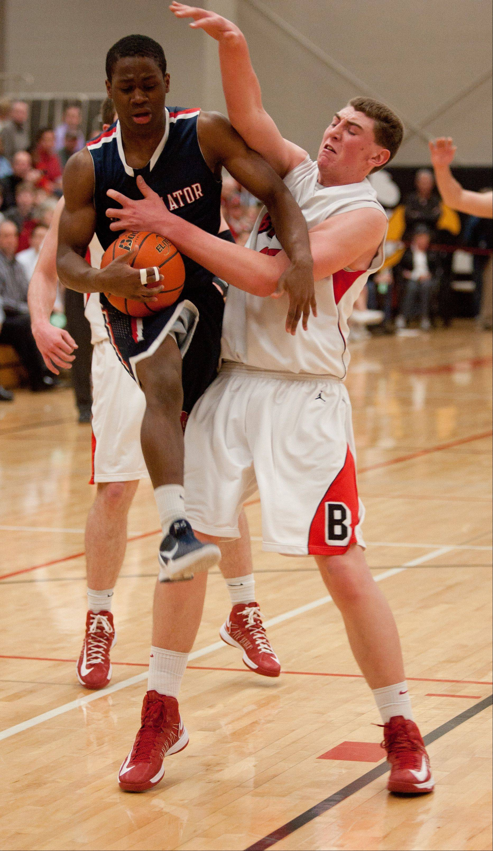 Benet's Sean O'Mara uses his body against St. Viator during boys basketball action in Lisle.