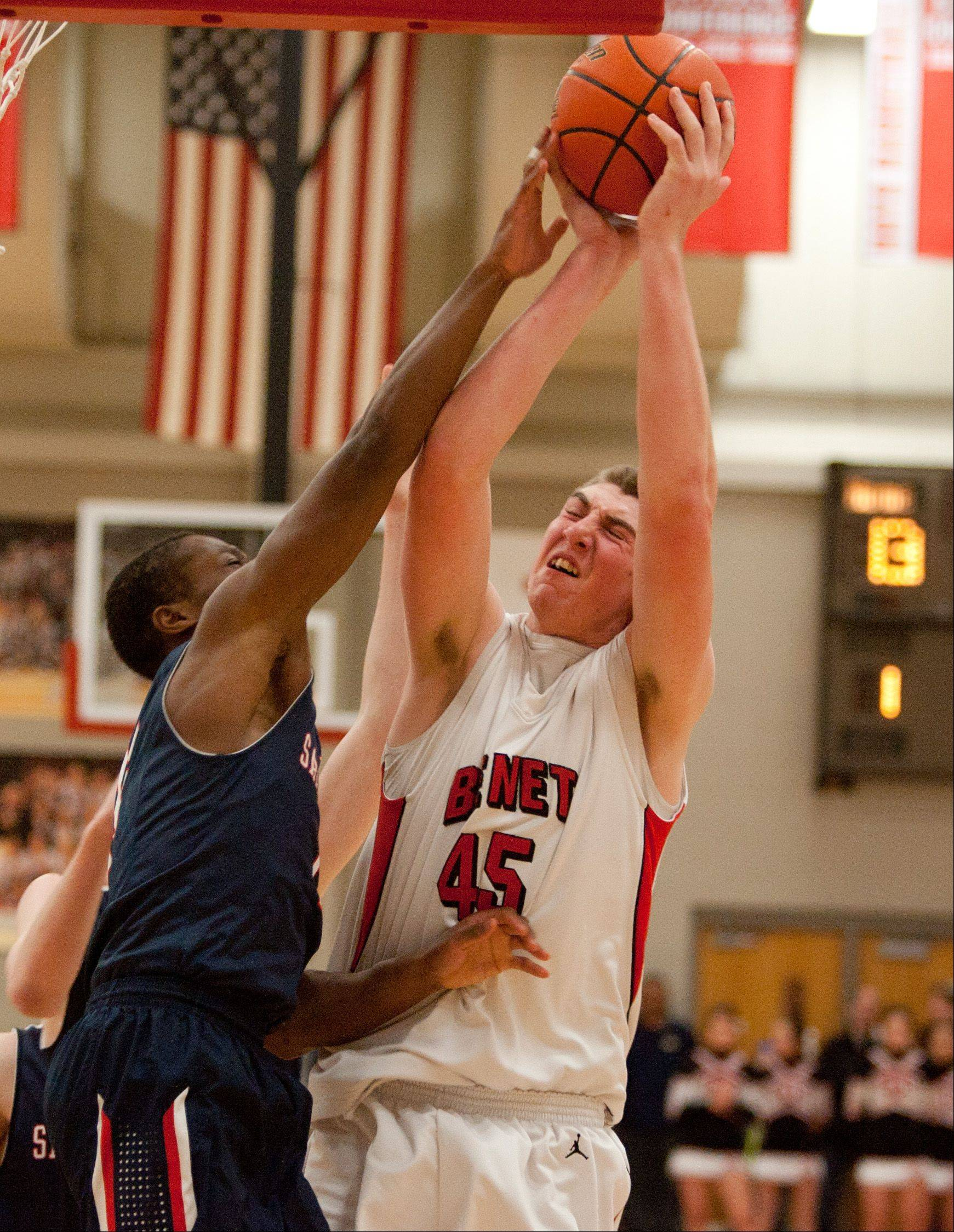 Benet's Sean O'Mara moves to the basket against St. Viator.