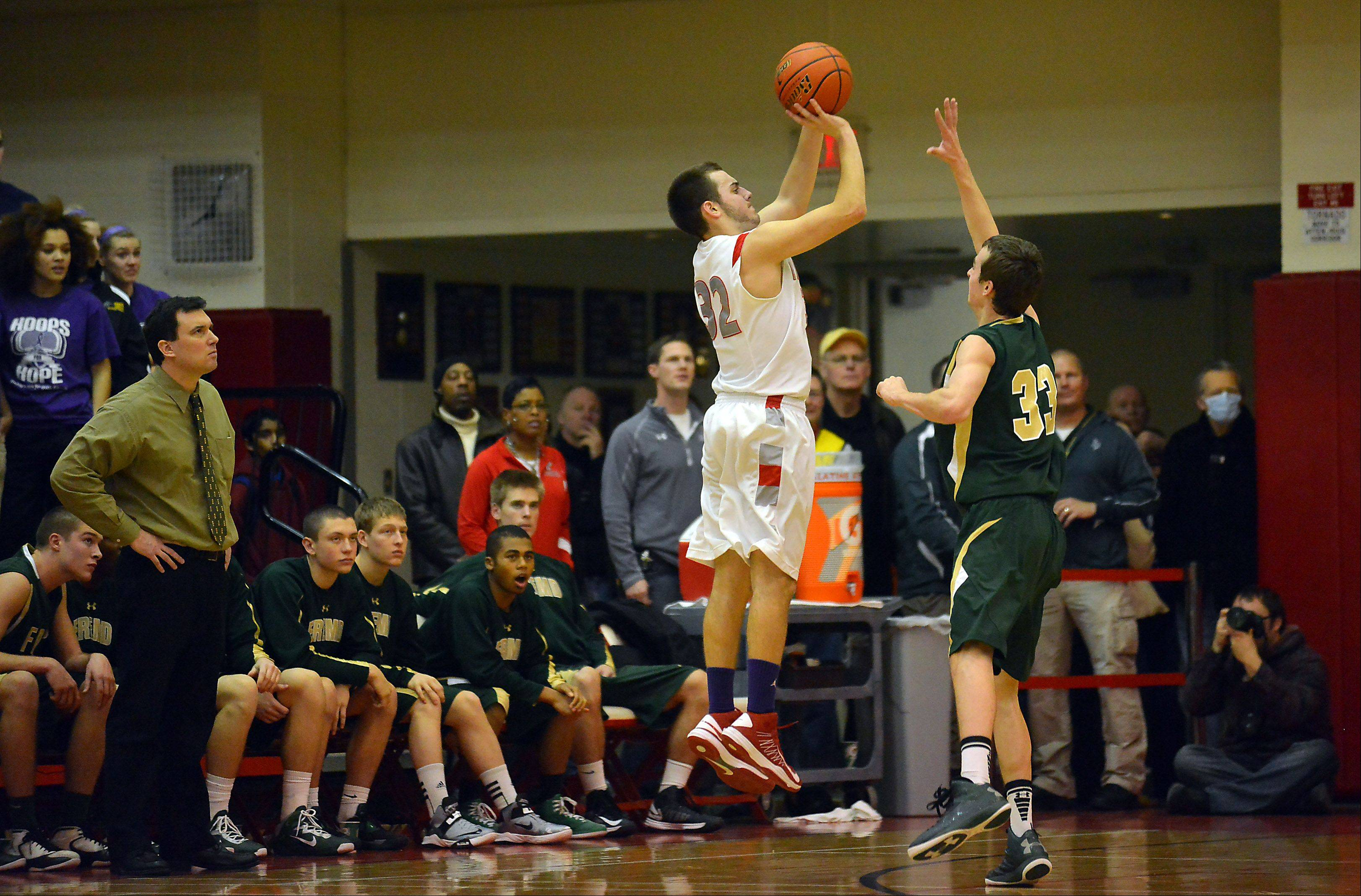 Mark Welsh/mwelsh@dailyherald.com Palatine's Greg Grana shoots over Fremd's Sean Benka as he attempts to block the shot in the boys varsity matchup at Palatine High School on Friday.