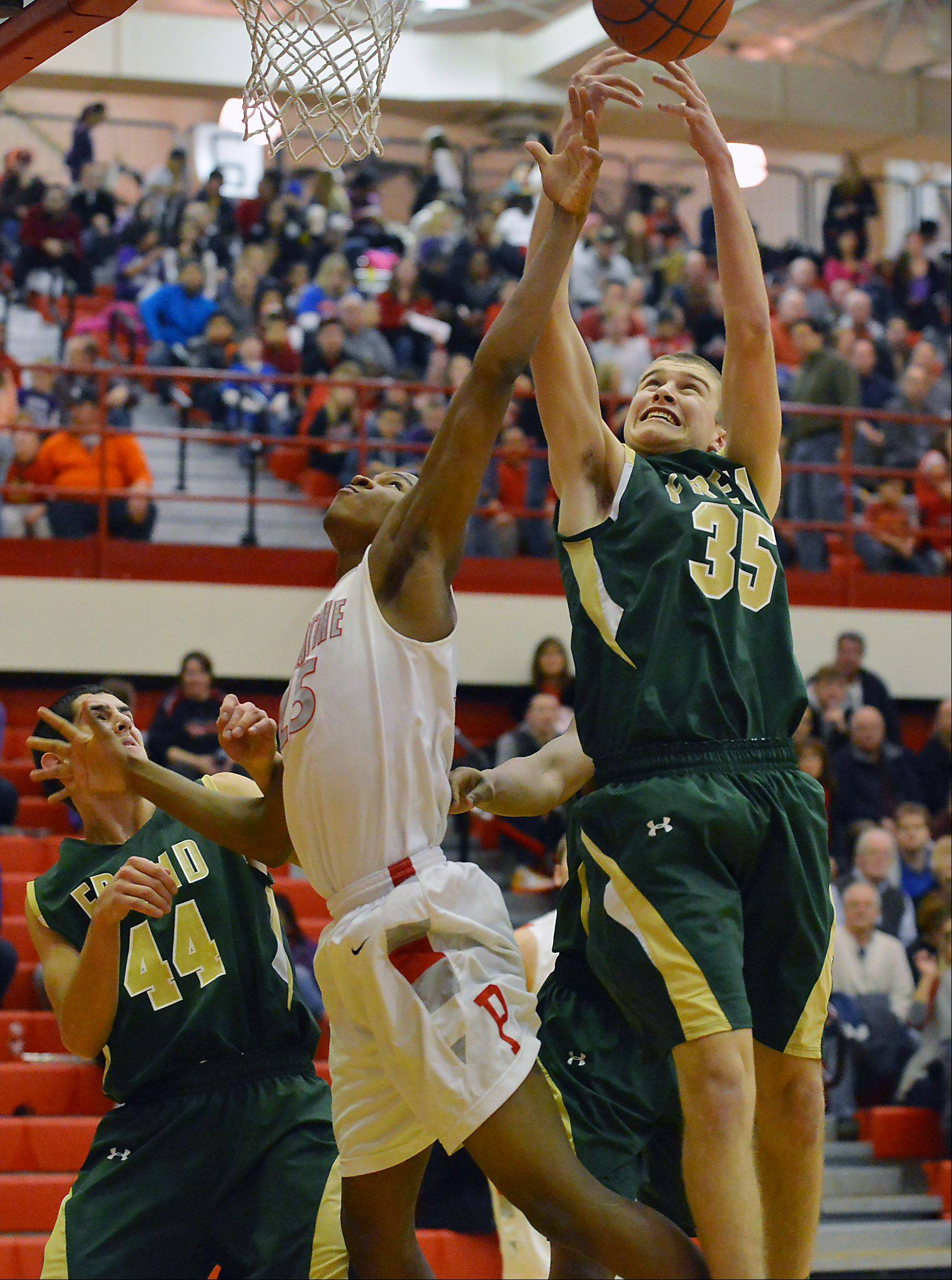 Fremd's Tom Cordell and Palatine's Mike Williams battle for a rebound .
