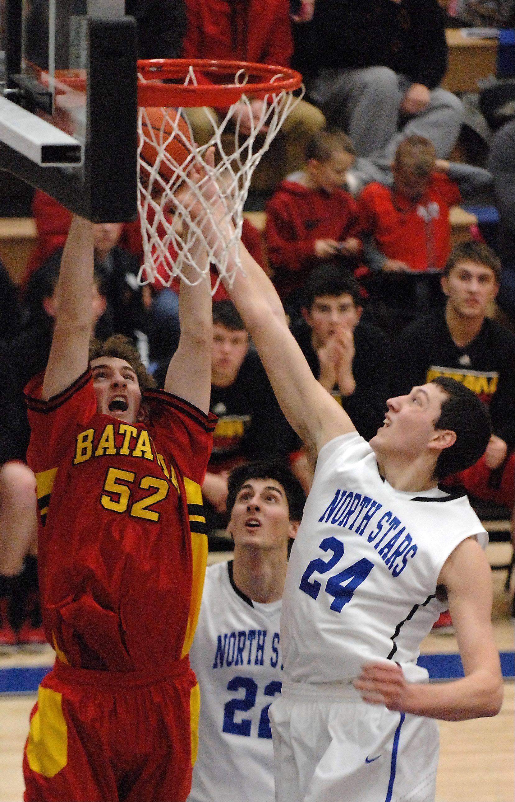 Batavia's Luke Horton and St. Charles North's Chris Preocanin battle for a rebound.