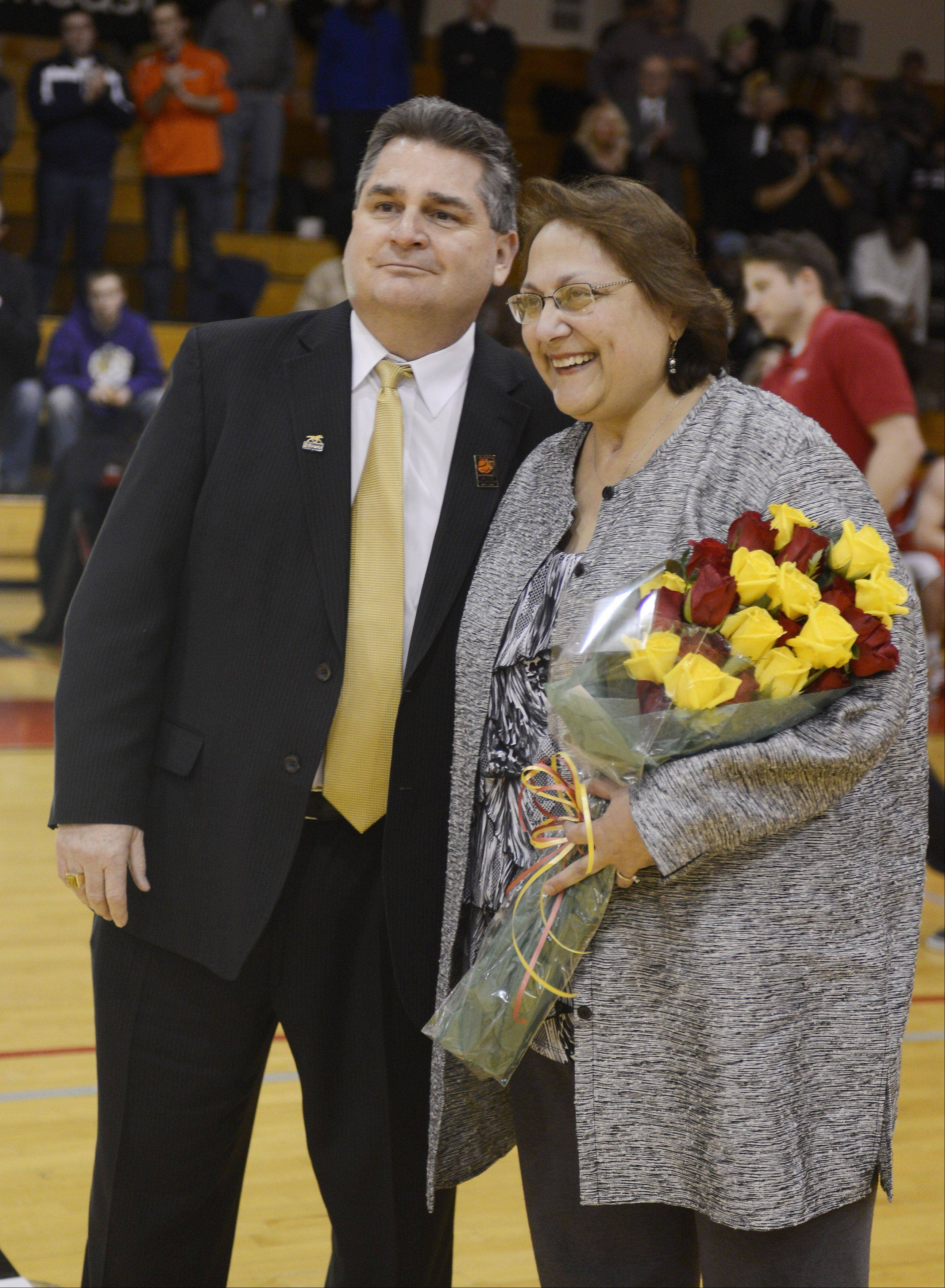 Retired Batavia boys basketball coach Jim Roberts and his wife Sylvia are honored during the 20th anniversary Night of Hoops at the school Saturday night.