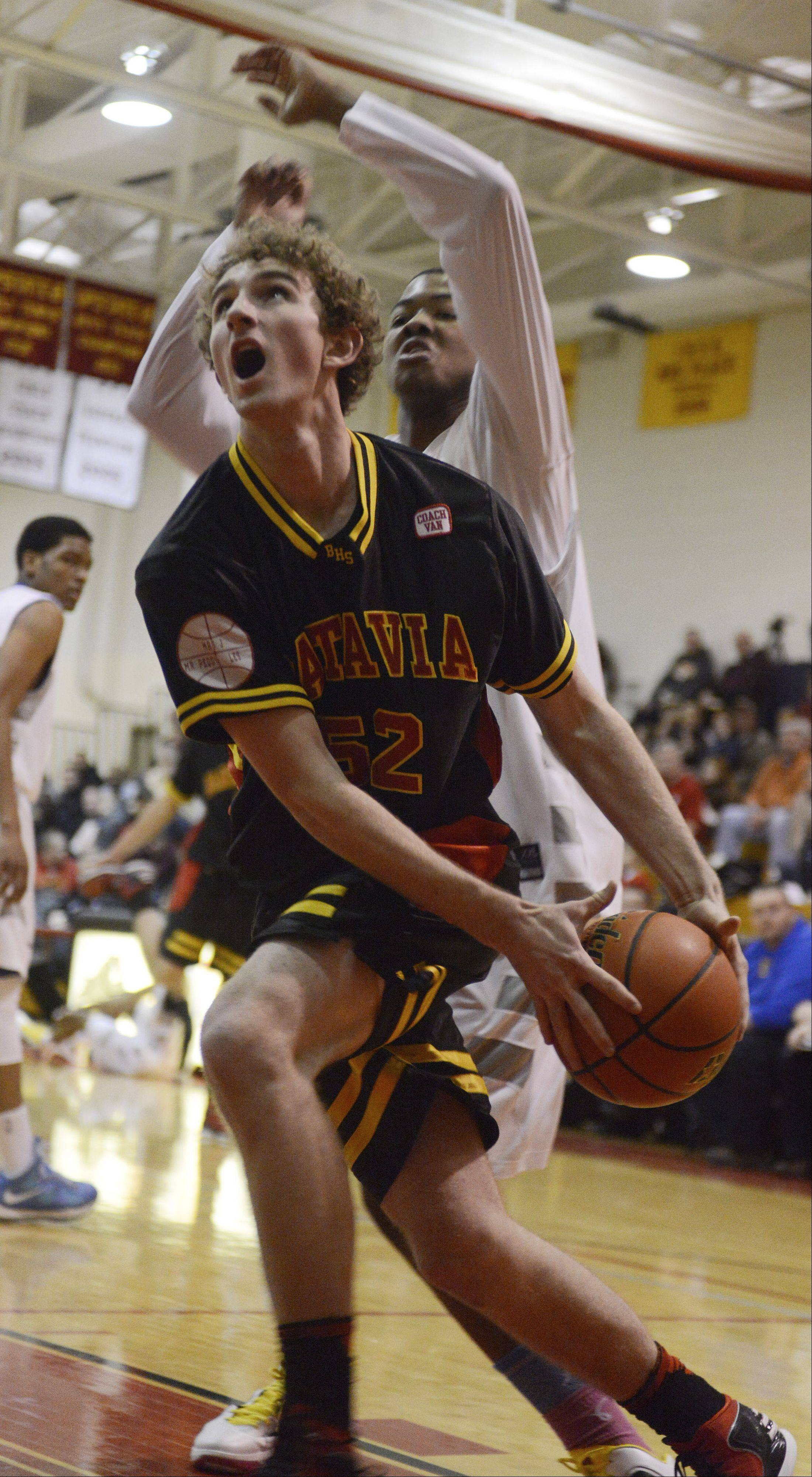 Batavia's Luke Horton drives to the basket against De La Salle during the 20th anniversary Night of Hoops at Batavia High School Saturday night.