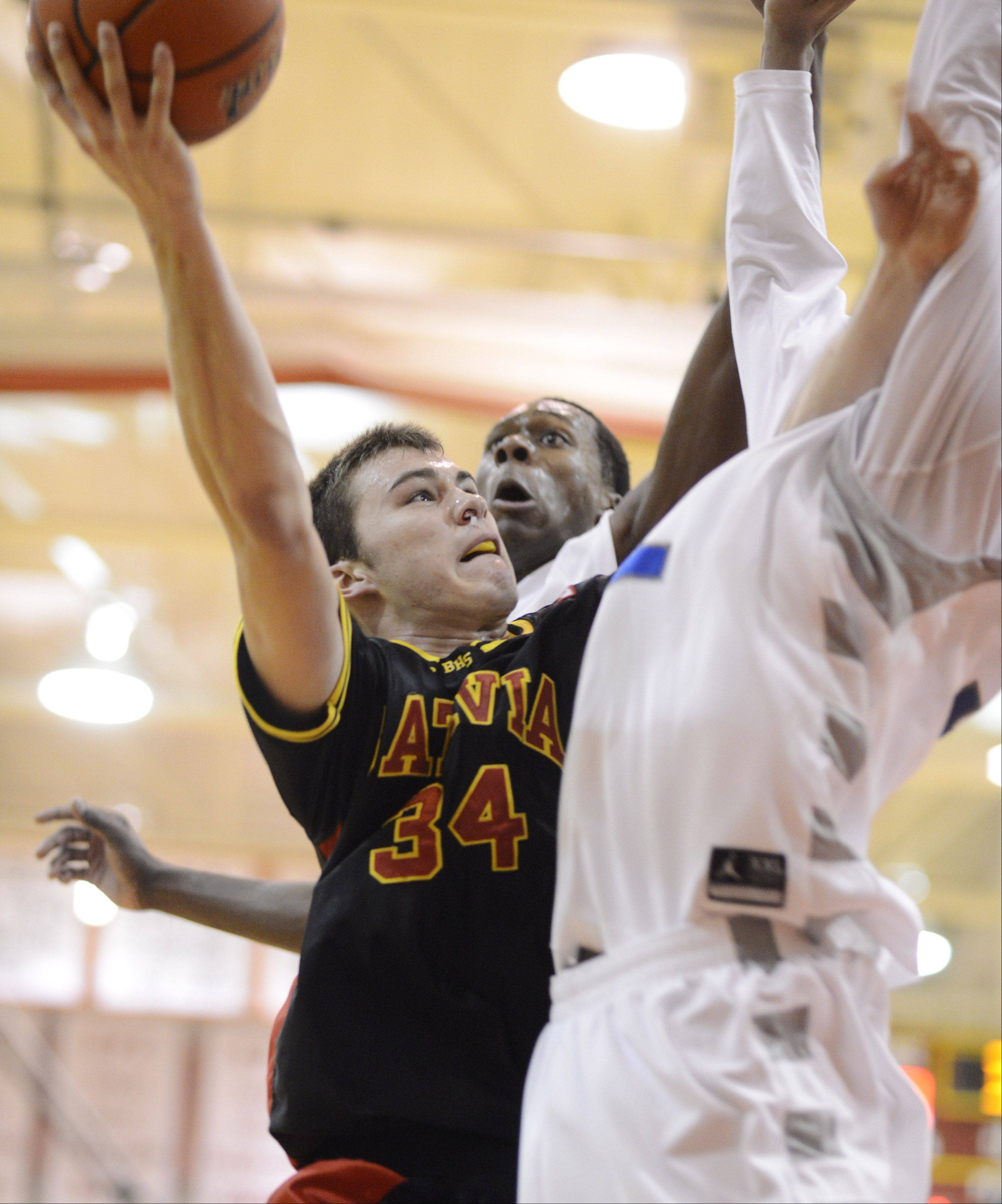 Batavia's Zach Strittmatter takes a shot against De La Salle during the 20th anniversary Night of Hoops at Batavia High School Saturday night.
