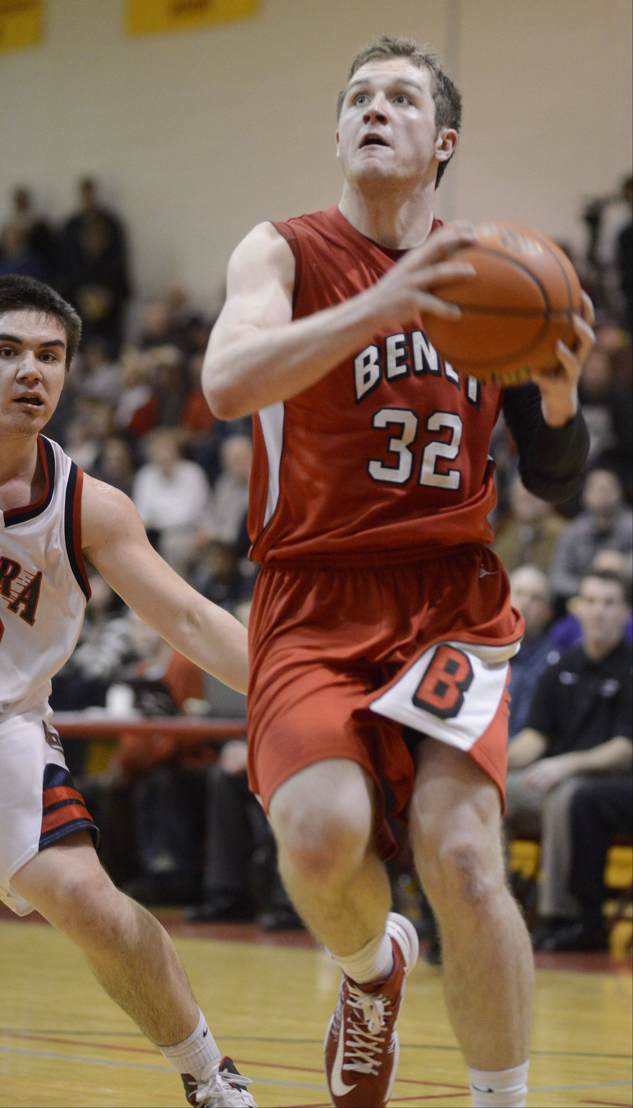 Benet Academy's Pat McInerney drives to the basket against West Aurora during the 20th anniversary Night of Hoops at Batavia High School Saturday night.