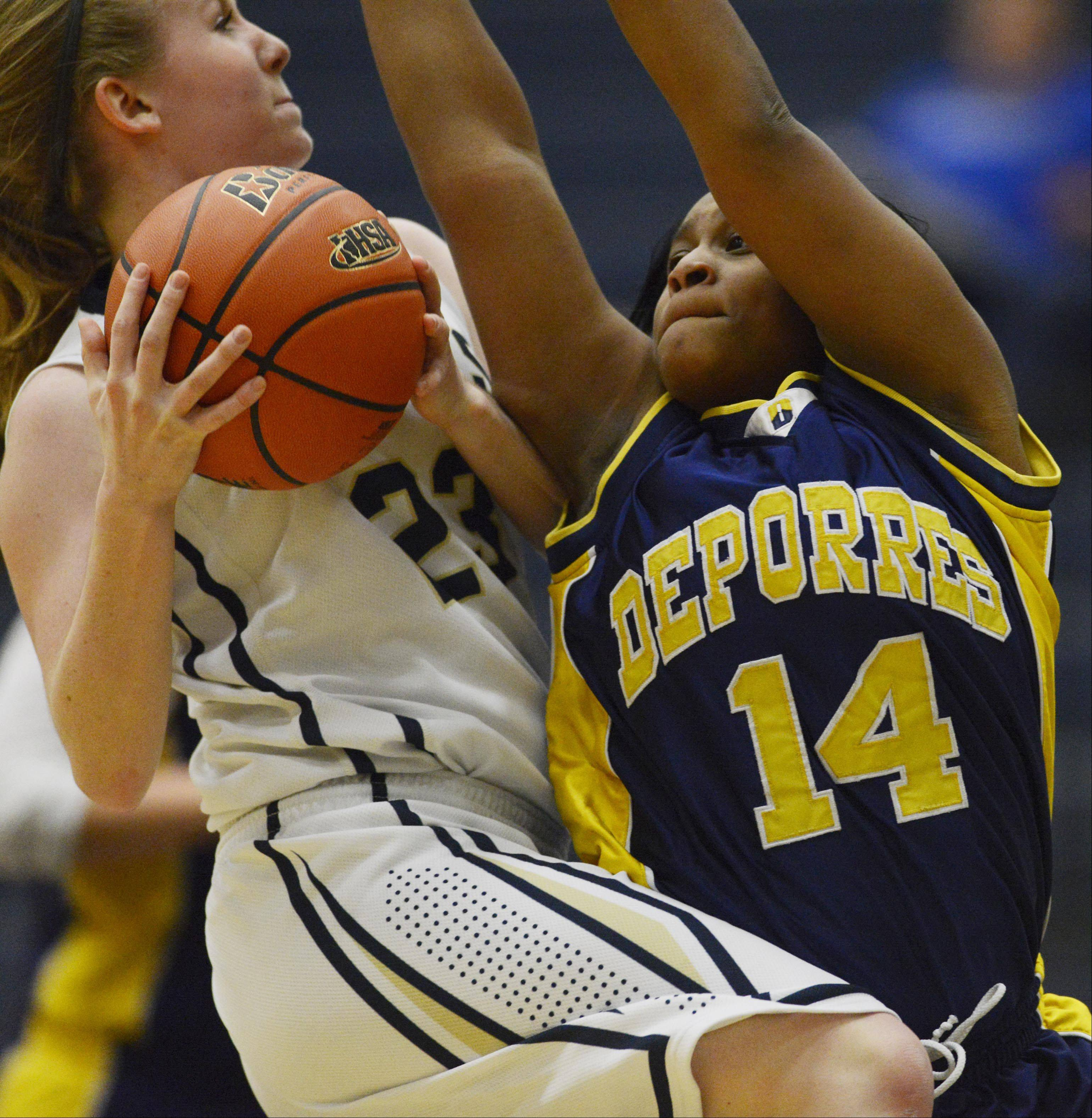 Harvest Christian Academy's Morgan Lockwood runs into the defense of Cristo Rey St. Martin's Jessena Fields Monday in Elgin.
