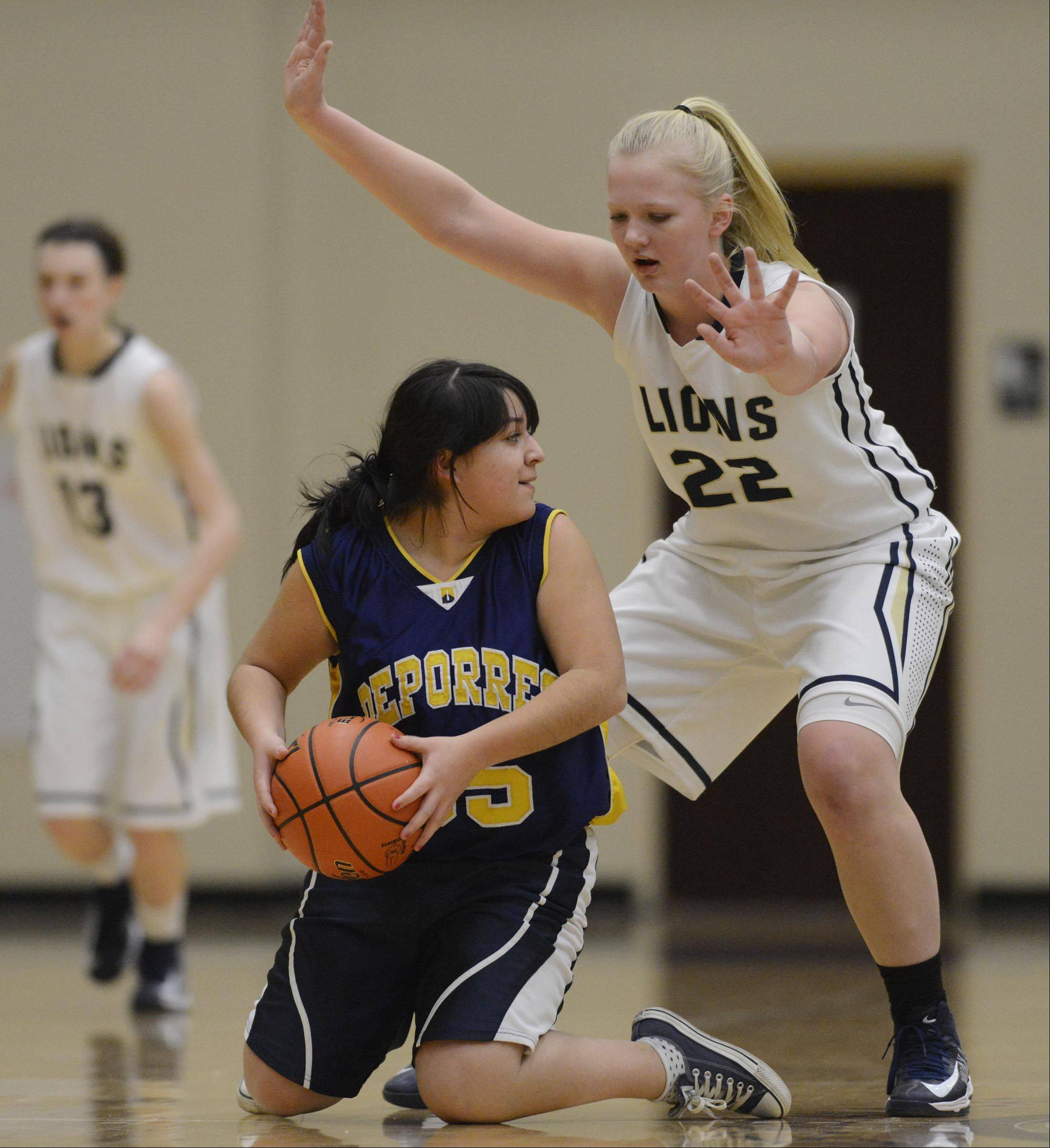 Harvest Christian Academy's Rachel Oostdyk guards Cristo Rey St. Martin's Destiny Perez Monday in Elgin.