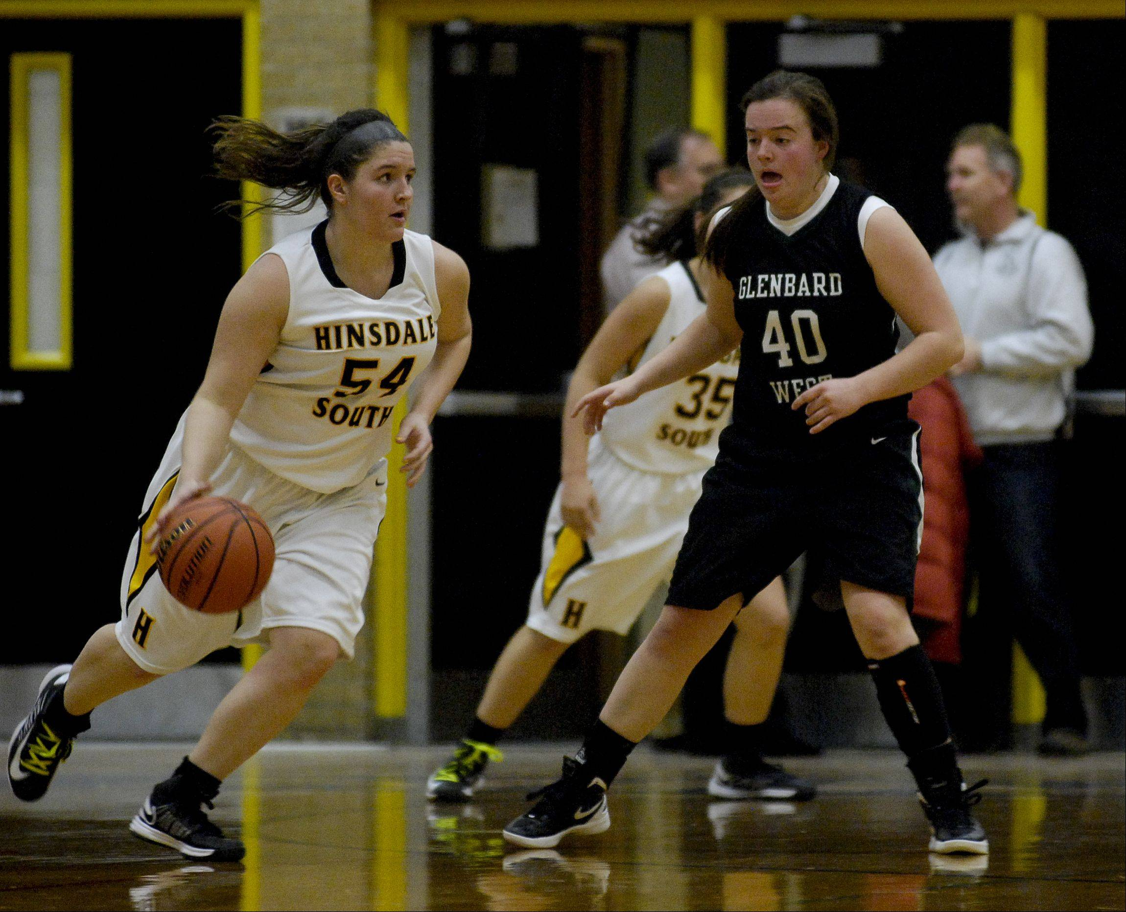 MacKenzie Kern of Hinsdale South High School drives around Claire Graham of Glenbard West.